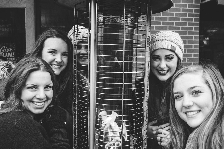 Black and white image of Amanda Lynn's Senior Elite Team standing around fire in downtown Oklahoma City.