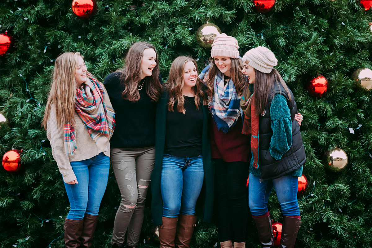 Amanda Lynn Photography's Elite Senior Models standing in front of Christmas tree in downtown Oklahoma City.