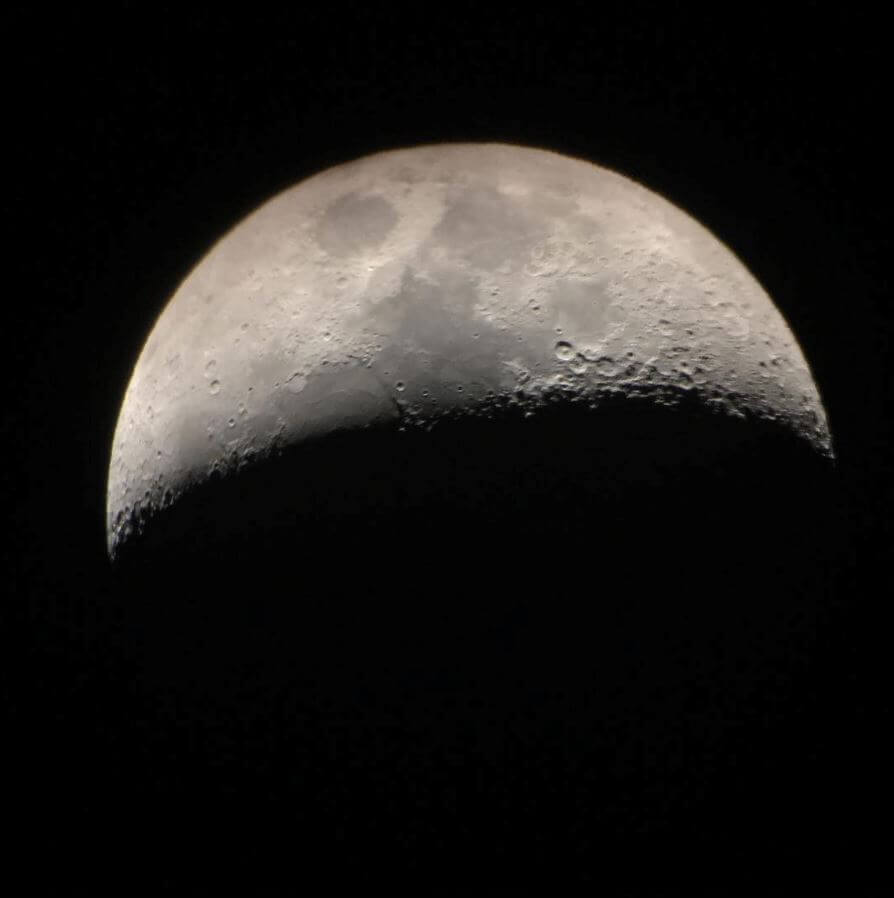This is a photo of the moon through a telescope that Mo built in our 700 square-foot condo. For real.