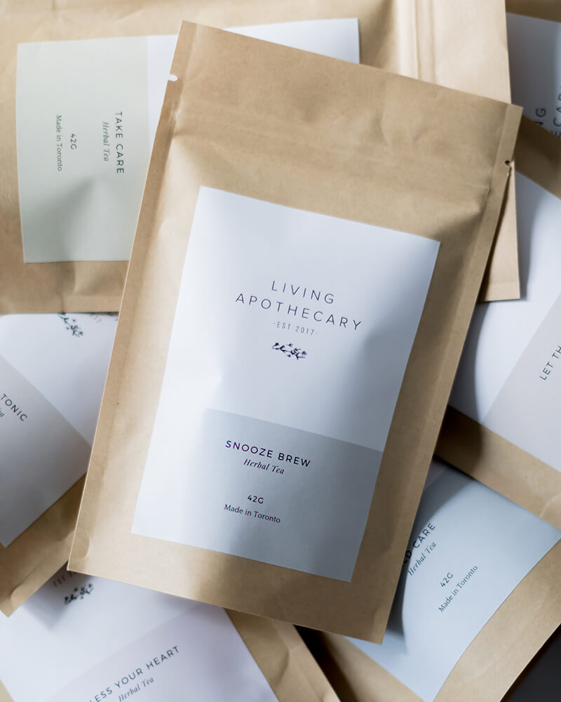 living apothecary herbal tea wellness brand packaging