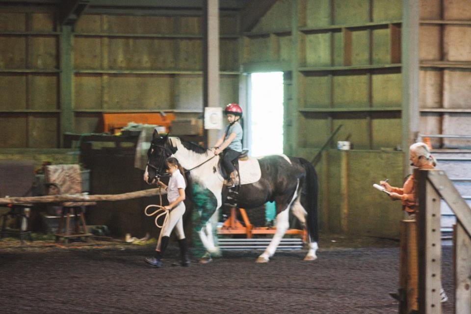 Laura leads Hayden around on Keenan for the Lead Line division at last years schooling show.