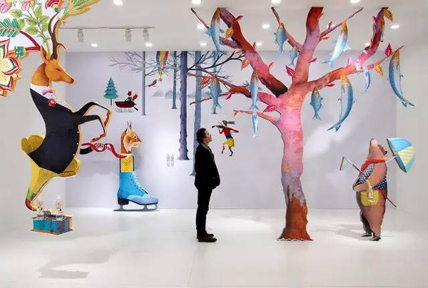 From what I gathered online, looks like Brett also realized his illustrations as an installation in the visitor center of Nongfu headquarters. I love the fish like leaves on the tree…