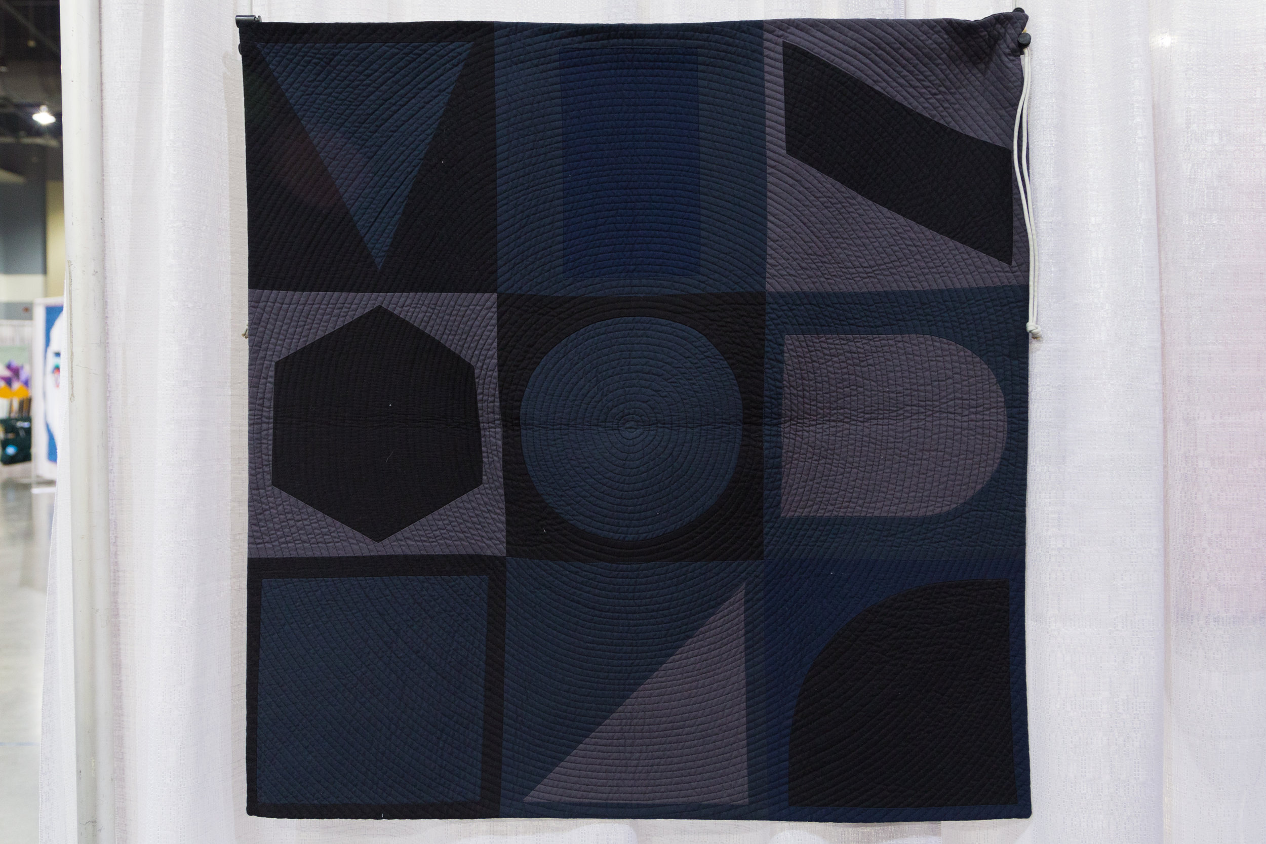 "3rd Place: Dark Geometry  33"" x 33"" Pieced and quilted by Susan McKinney Waltham, MA, United States Boston Modern Quilt Guild"