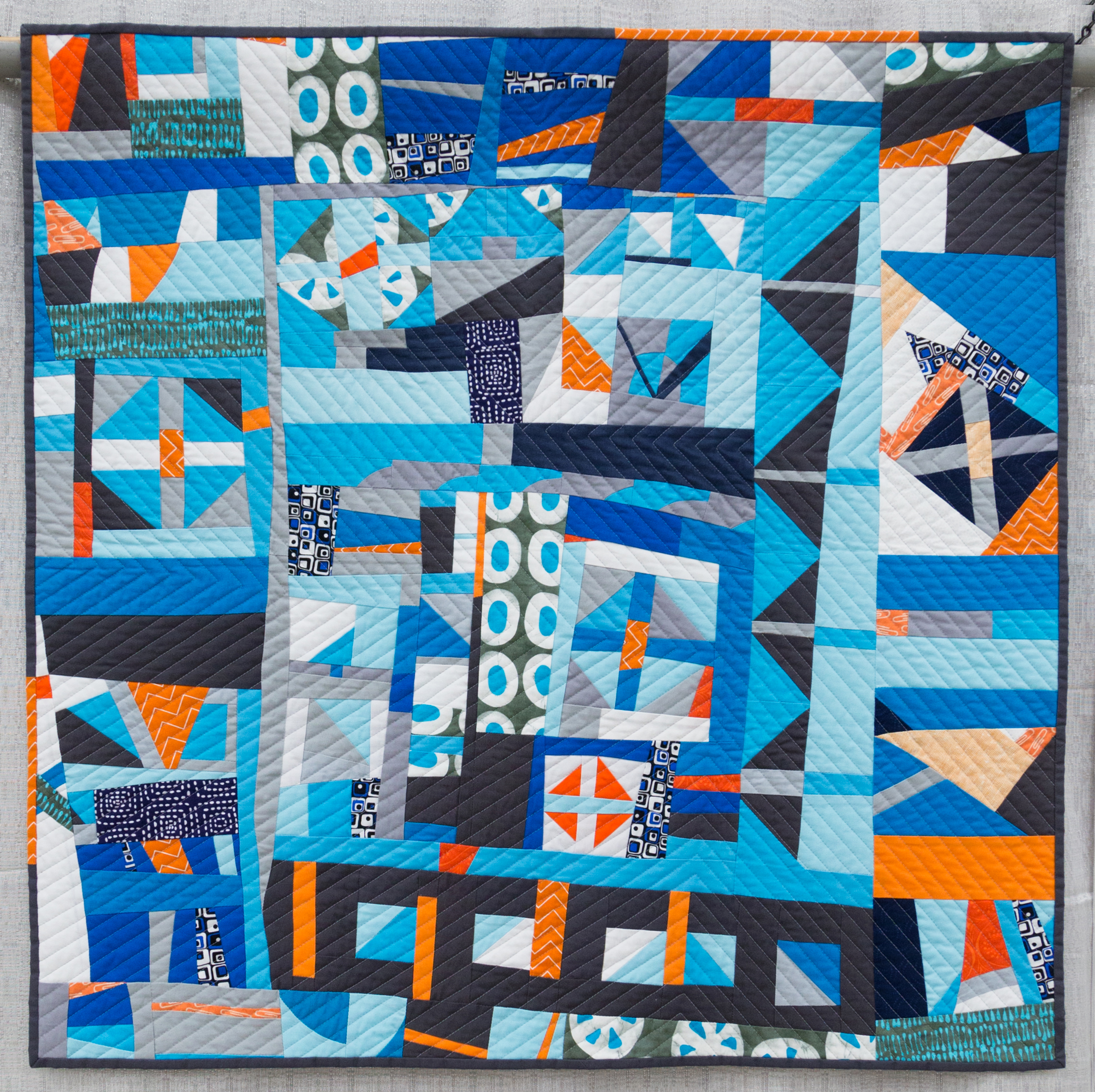 """2nd Place: Churn Dash 2: Complementary  33"""" x 33"""" Pieced by Martha Peterson, Deborah Ferguson and Chandra Wu Quilted by Martha Peterson Woodinville, Washington Seattle MQG"""
