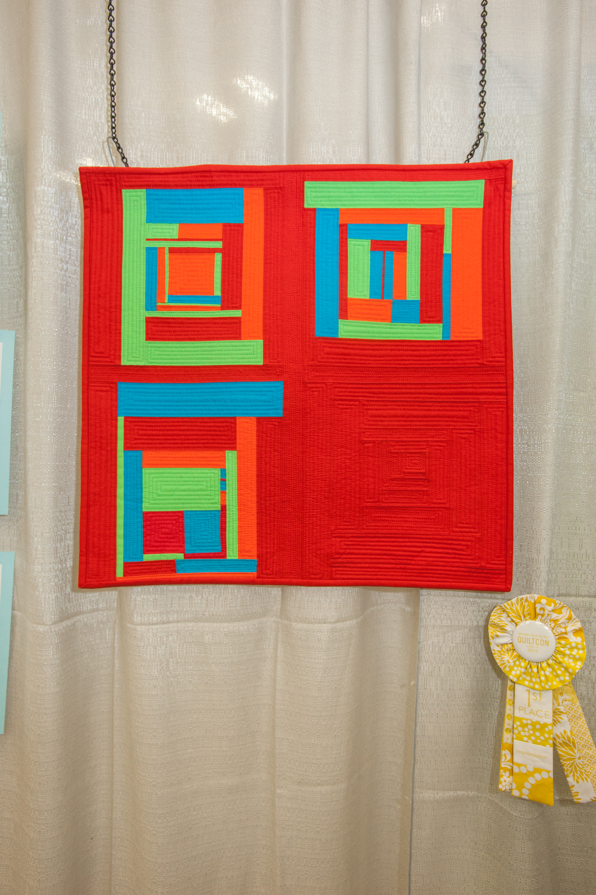 1st Place: Red Concentrate  Pieced and quilted by Lavialle Campbell
