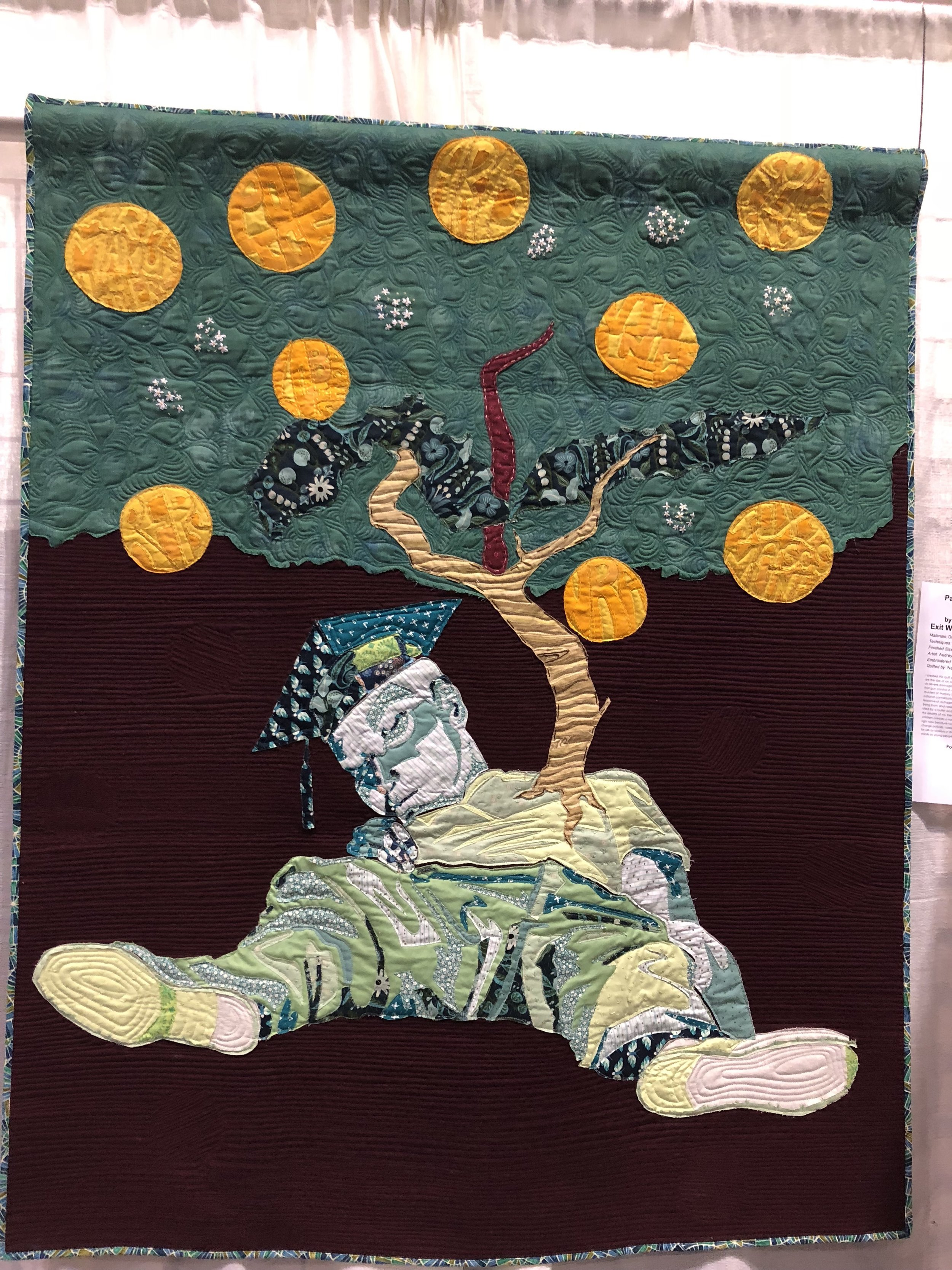 "2nd Place: Exit Wound  55"" x 60"" By Audrey Bernier Individual Member Antioch, California Quilted by Nancy Williams"