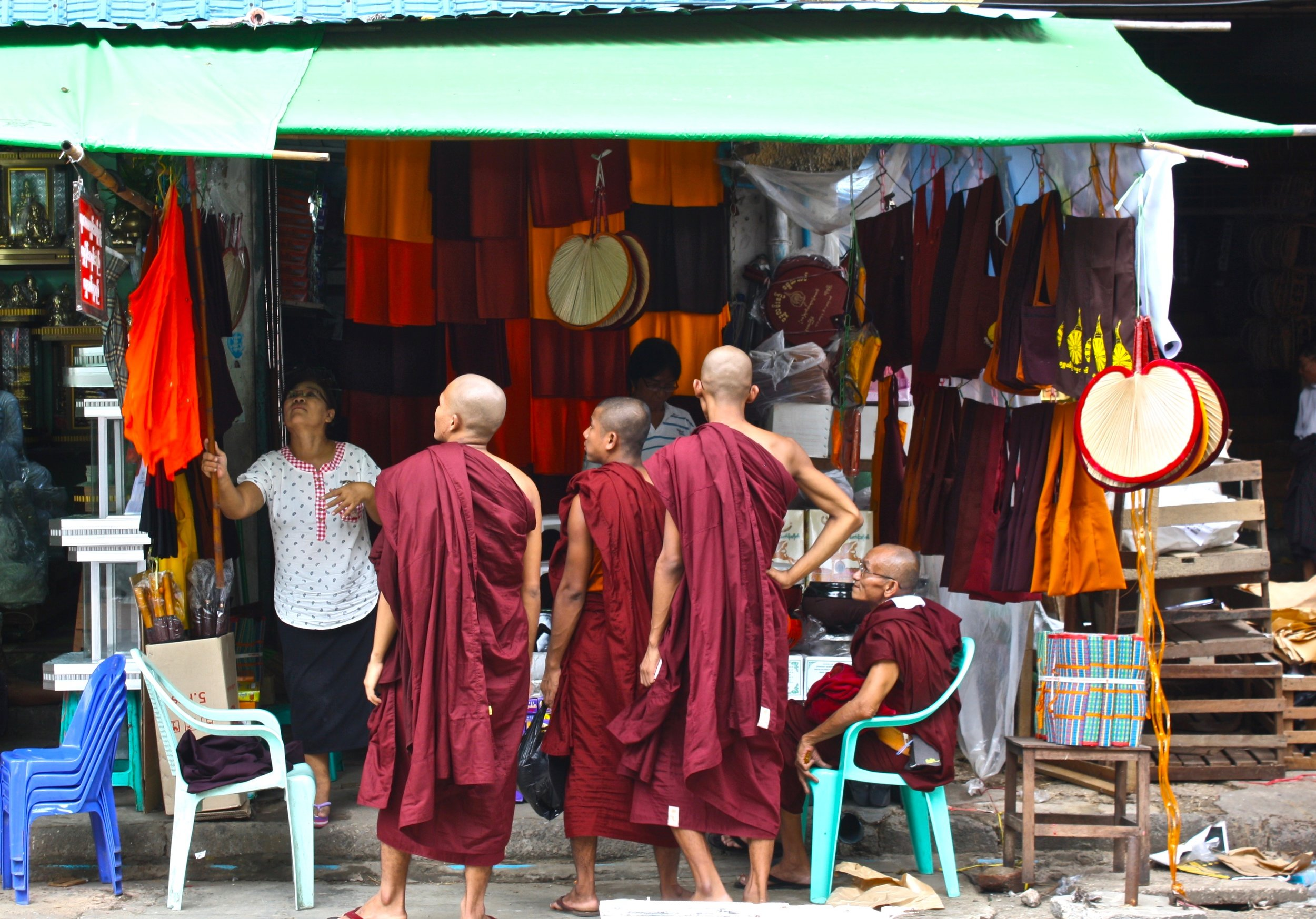 Monks in front of Shwedagon Pagoda shopping for new robes.