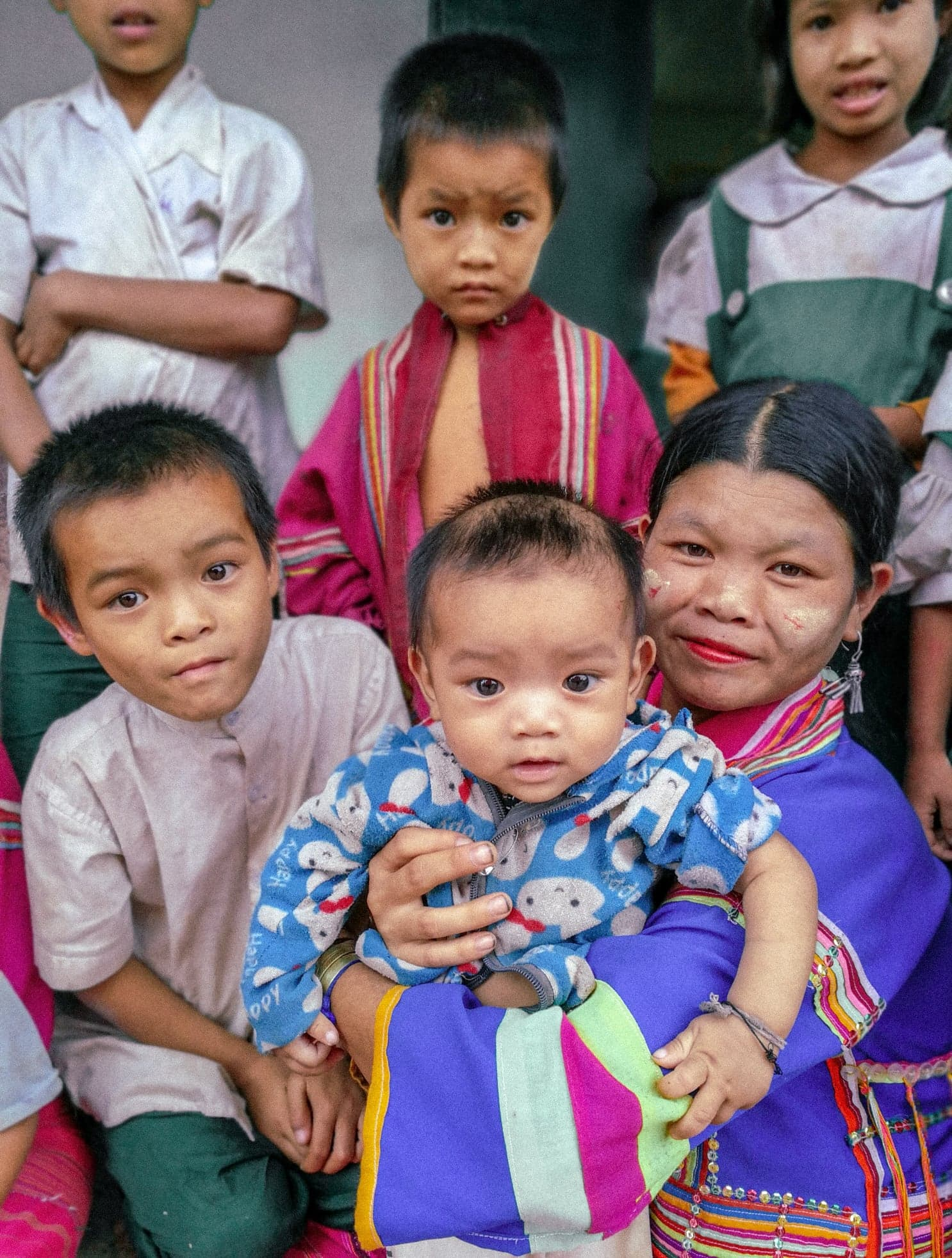 A beautiful family in a Palaung village in northern Shan State, Myanmar. Travel photography by Rosie Cornwell. Taken while on assignment for Build a School in Burma.