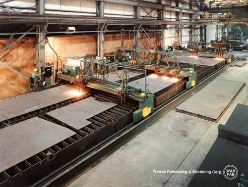 """Ohio Steel houses four Gantry L-Tec, CM 360 CNC Burning Machines with six torches each and burning capabilities up to 15"""" thick, 21' wide, and 90' long. A special torch assembly allows burning up to 22"""" thick. Burning tolerances capable of 1/32"""" depending on the thickness of the steel plate."""