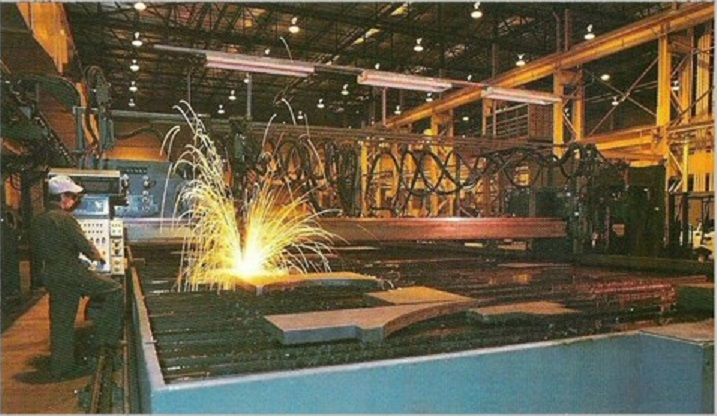 """Ohio Steel also houses one unique oxy fuel/plasma ESAB burn table with dual heads, 2 oxy heads, 2 plasma heads. The fuel torches can burn up to 22"""" thick. and cut plate 25' wide to 30' long.The plasma heads allow us to hold tighter tolerances and cuts down on grinding and cleaning time for burn jobs up to 1"""" thick."""