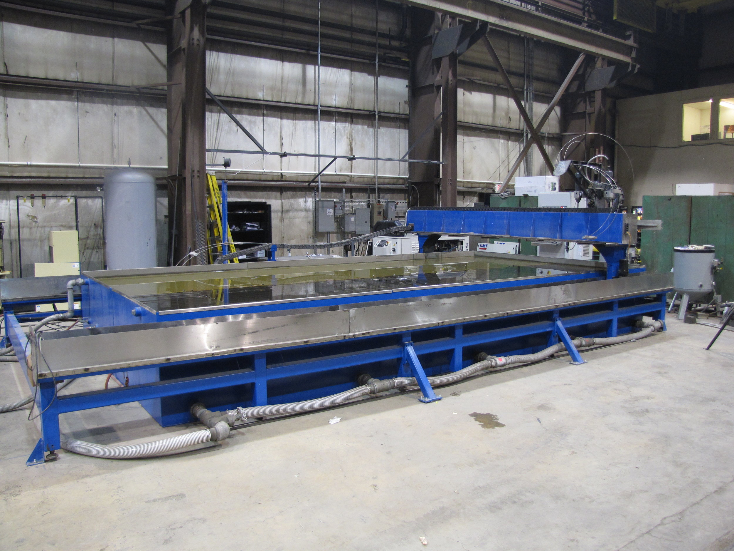 """Ohio Steel's newest addition to our burning capabilities is a Romeo CNC Waterjet machine. The x-axis travel 245.488"""" and y-axis travel is 112.625. The KMT Streamline water intensifier operates at 60,000 psi with single or dual heads cutting from 3"""" to 61"""" inches apart. Any material can be cut up to 6"""" thick. The abrasive garnet mixed with high pressure water allows for clean burning on harder materials, cutting down on cleaning, grinding, and prep time for your raw materials."""