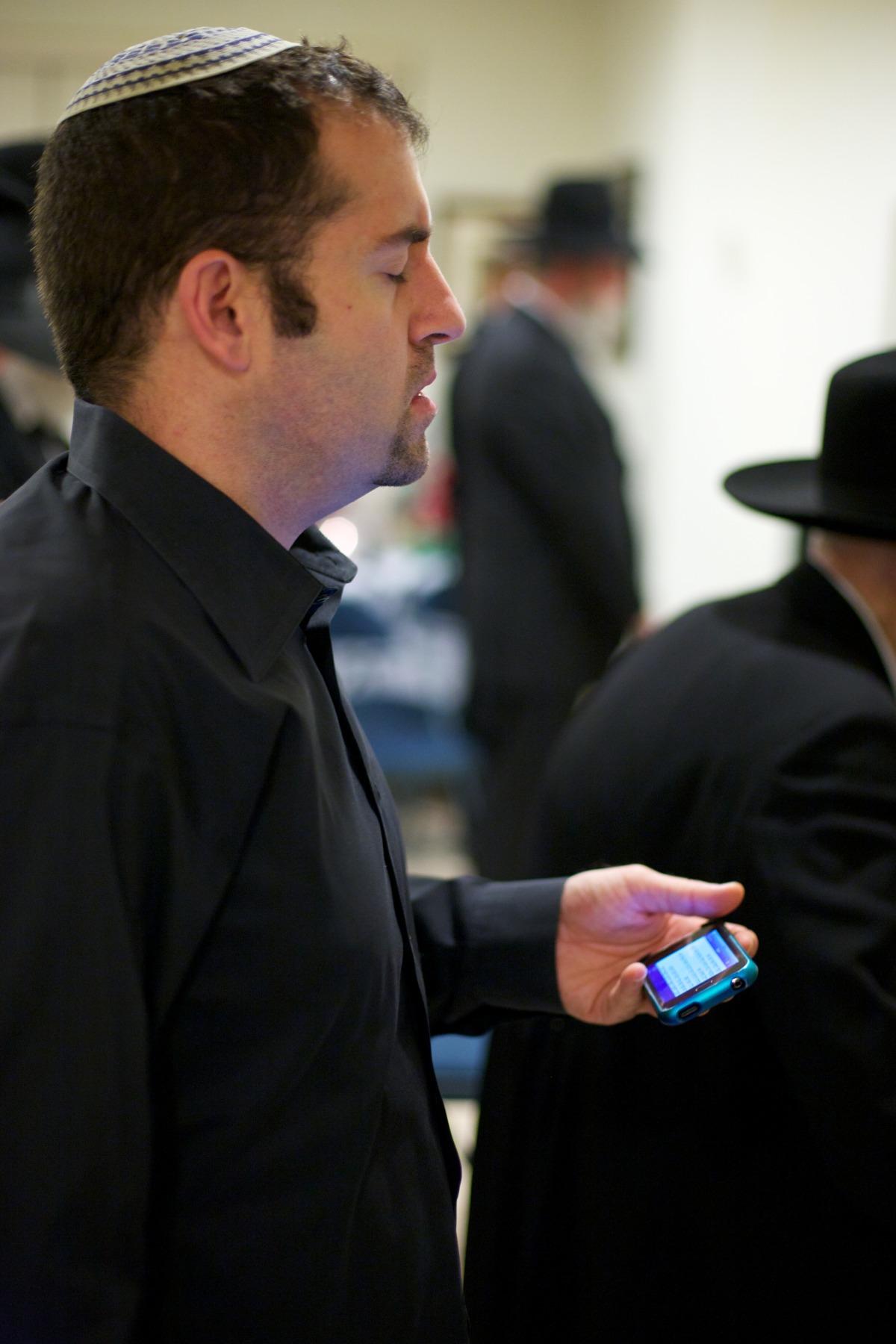 Micah Praying with an iPhone