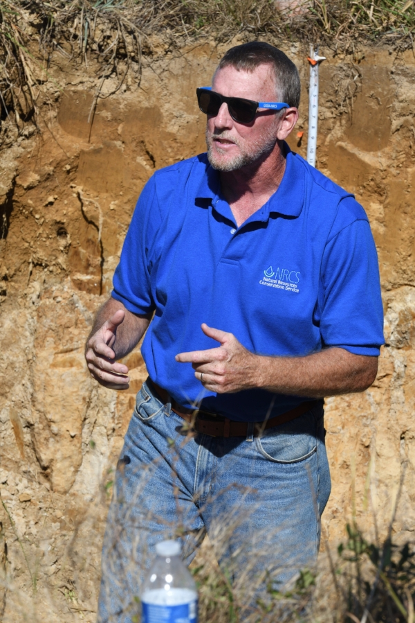 NRCS Soil Scientist Steve Blanford allowed participants to break pieces of fragipan with hammers. Photo from Farm Scholar, LLC.