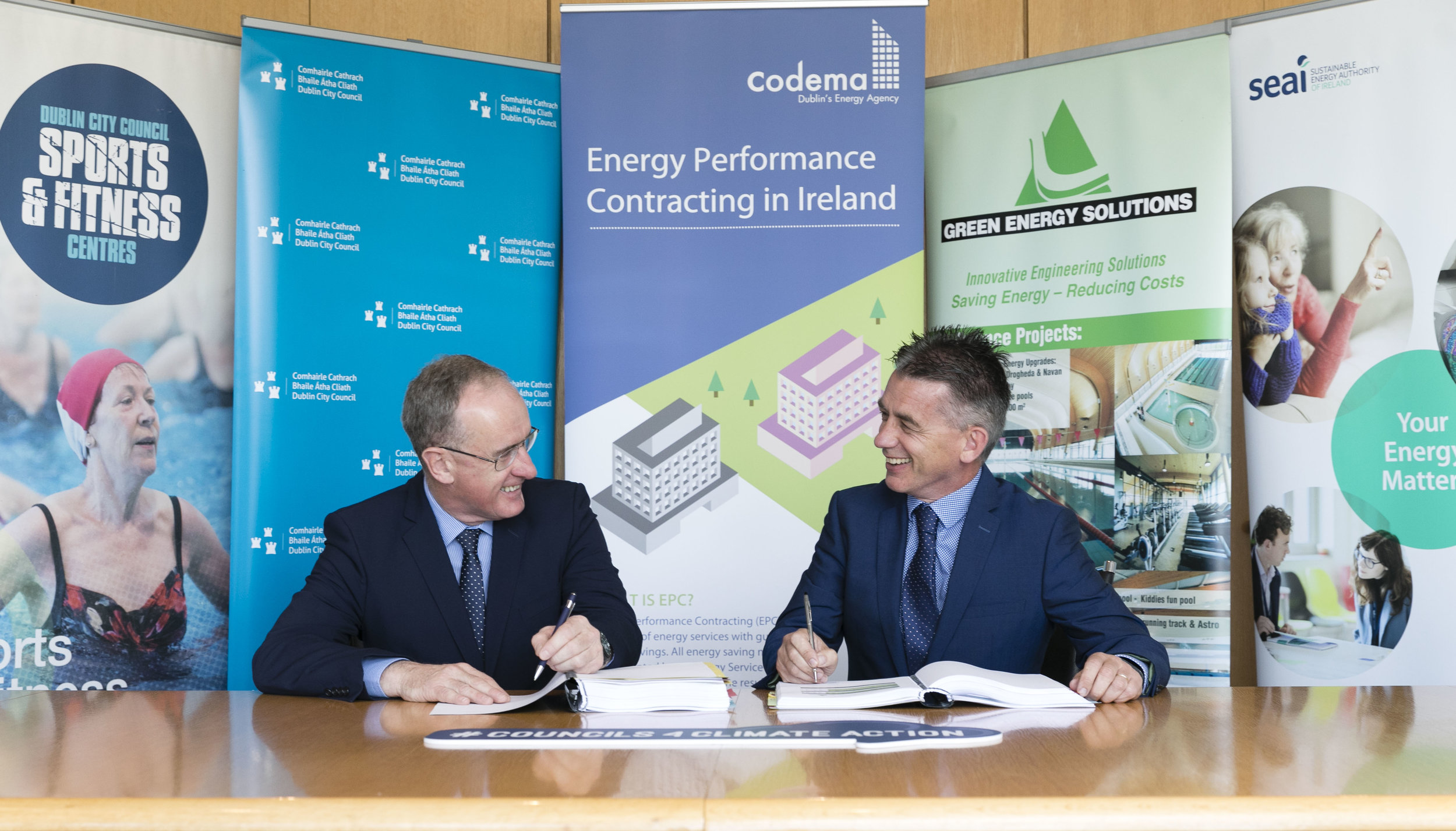 Owen Keegan Chief Executive Dublin City Council and Daniel Ring Managing Director Noel Lawler Green Energy Solutions signing the Energy Performance Contract. Photo credit: Fennell Photography