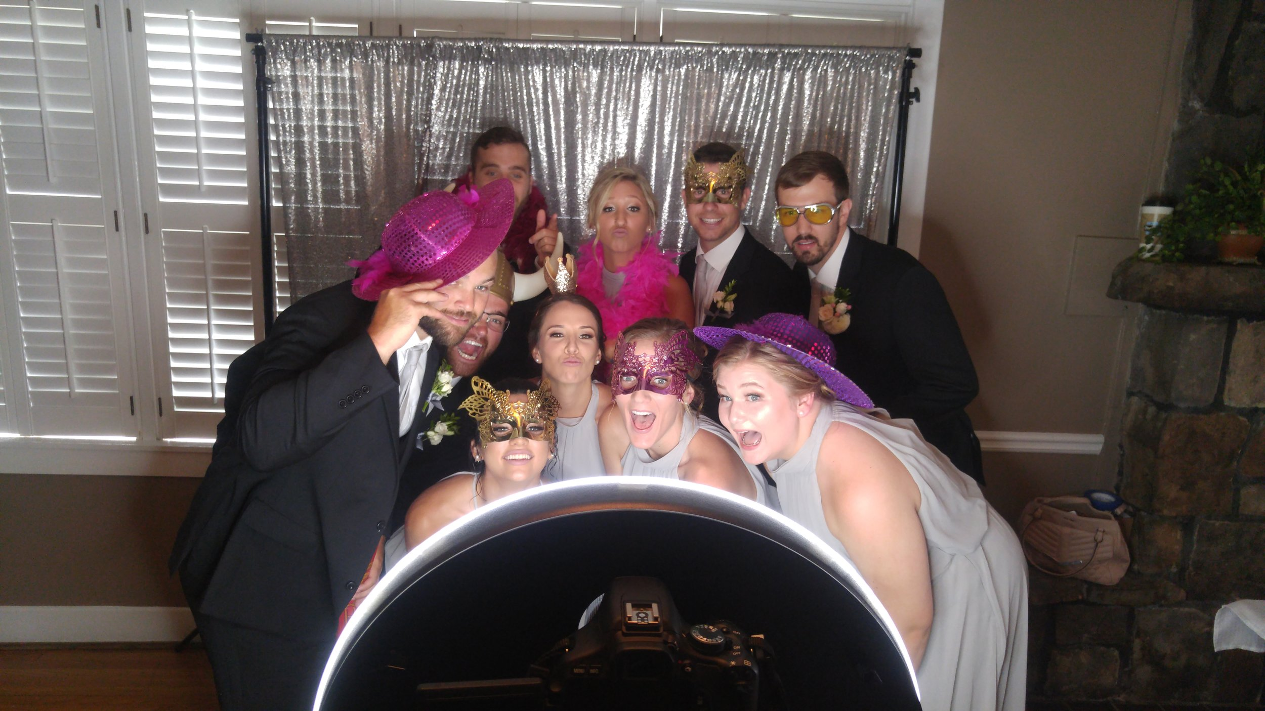 Wedding guests at a photo booth