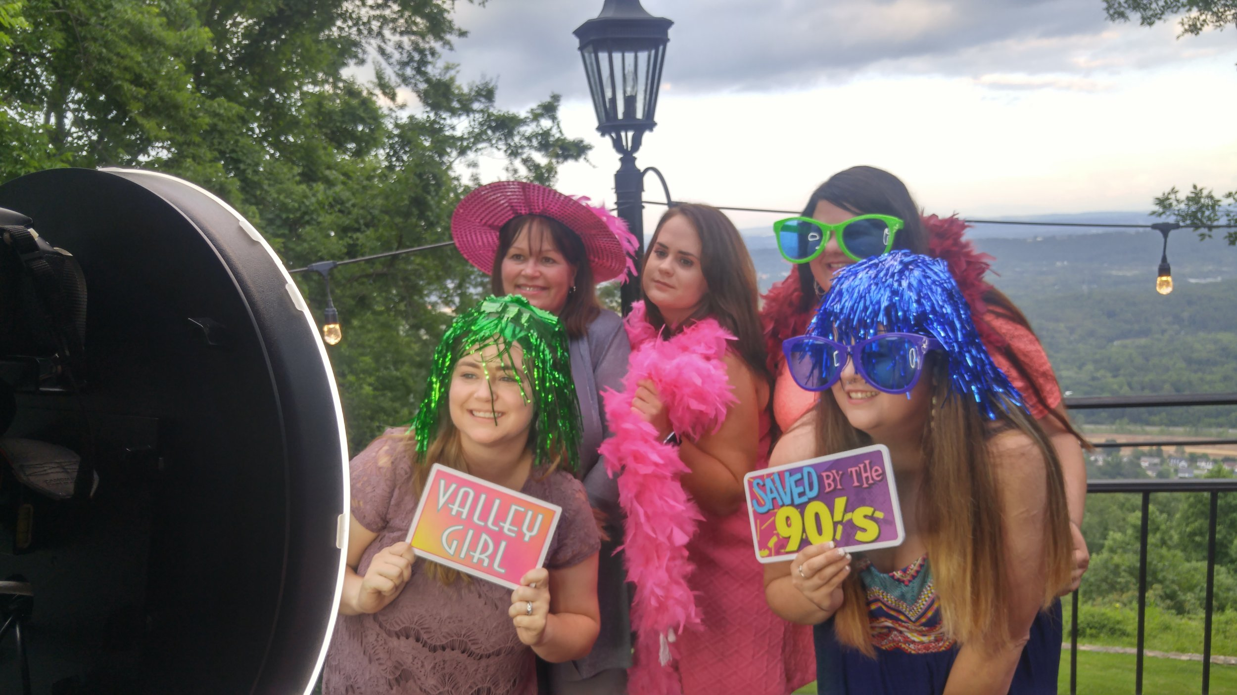 Wedding guests with silly props at a photo booth