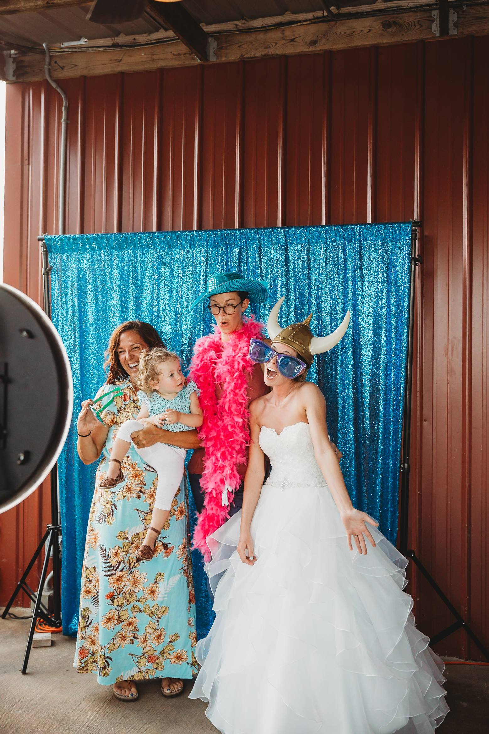 Bride and guests in a photo booth