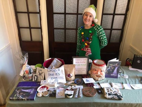 Sue managing the holiday raffle table at the holiday marker 2018