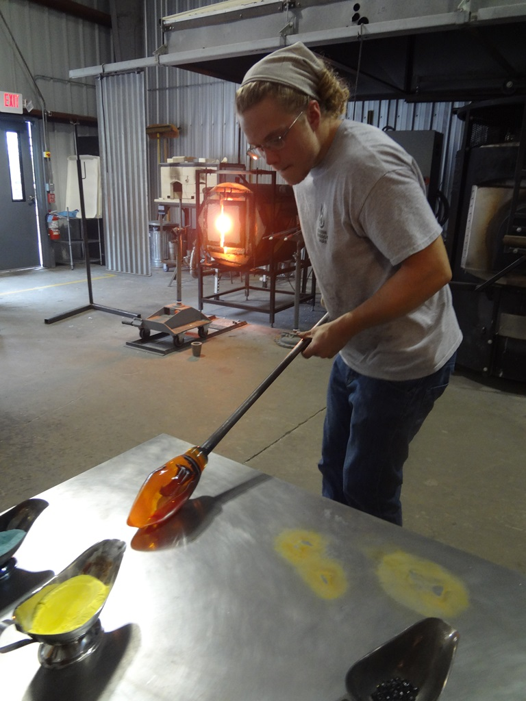 Cole Johnson blowing glass.