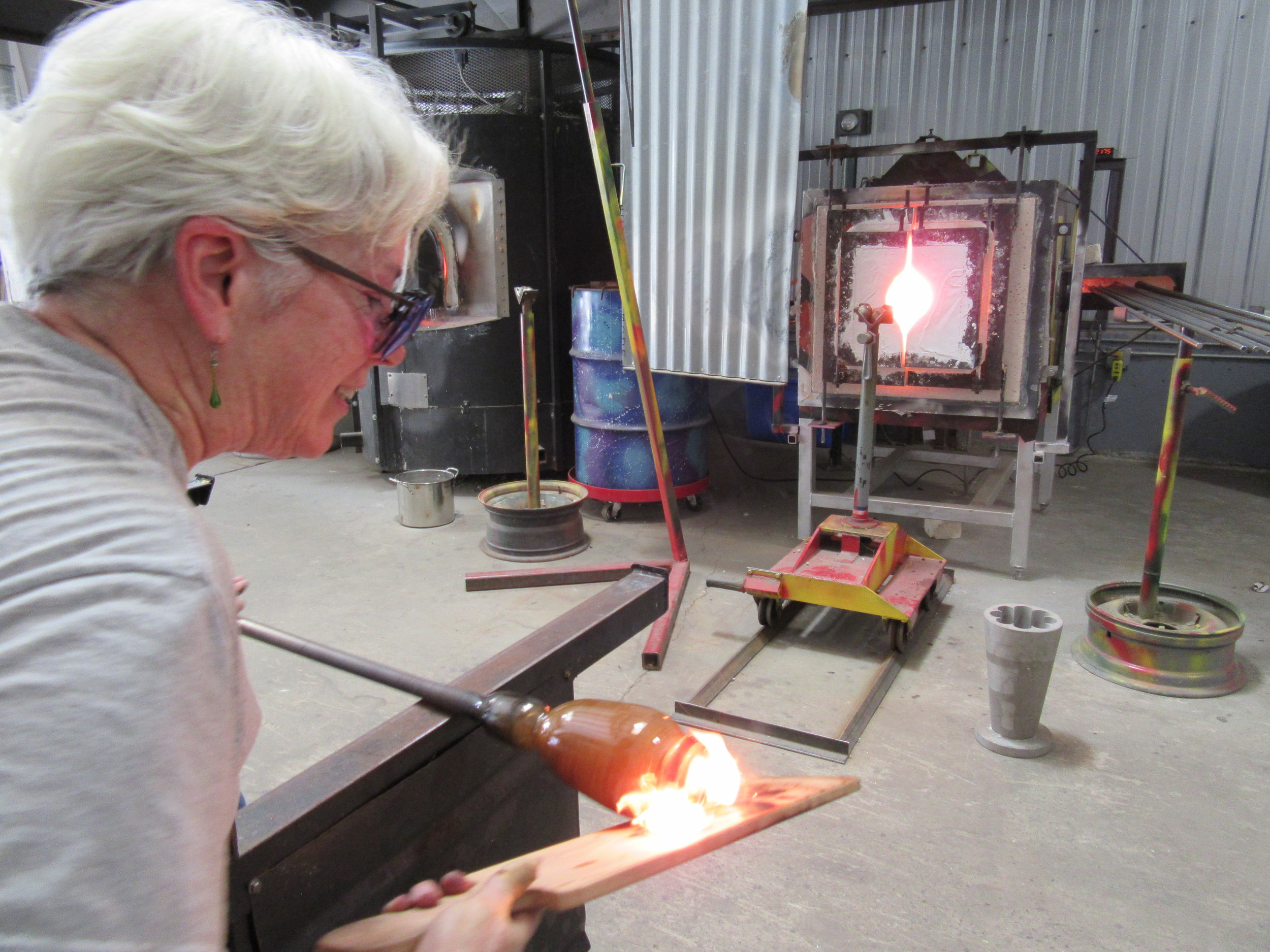 Judy McManus glassblowing.