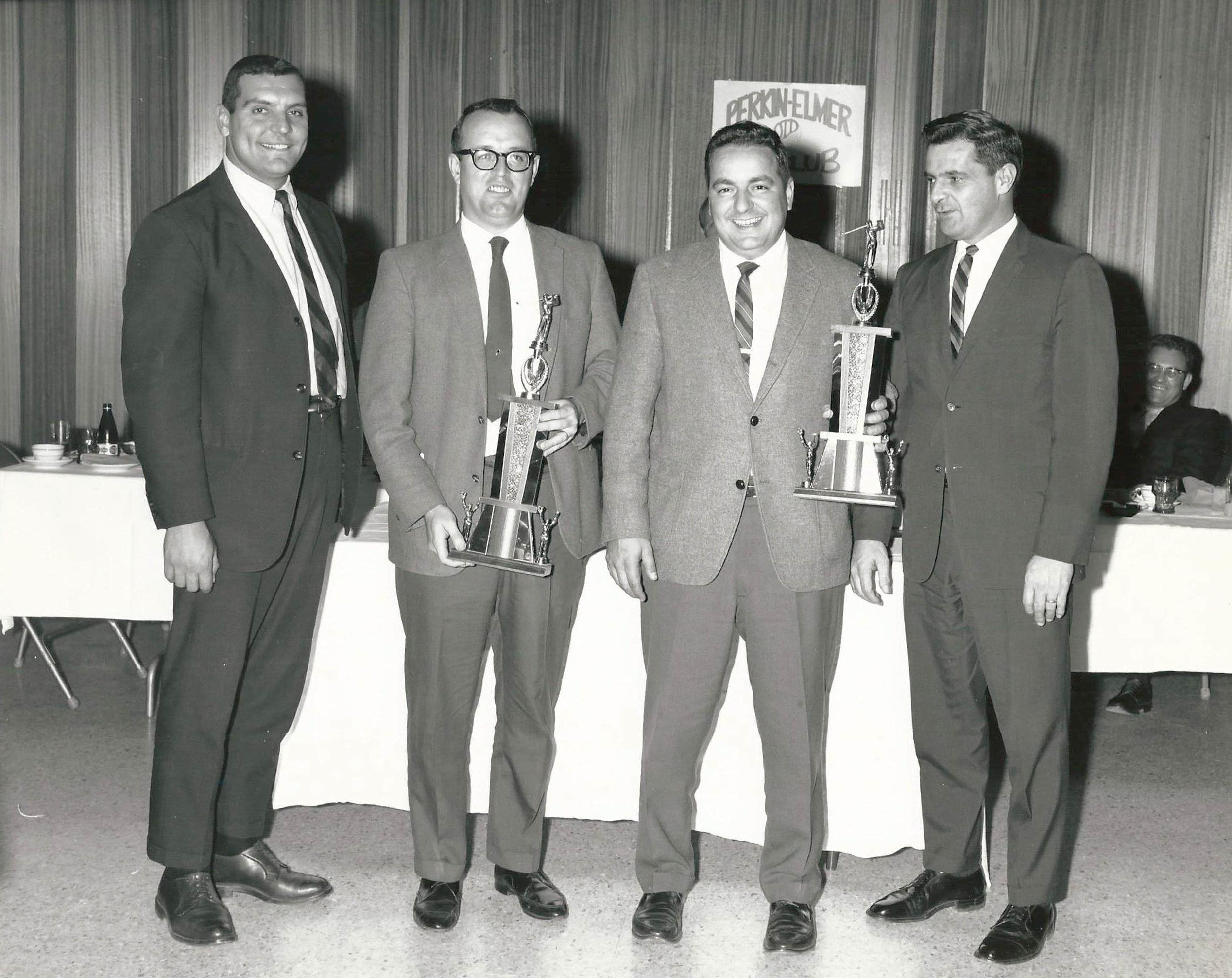 Sam golf jpg with trophy.jpg