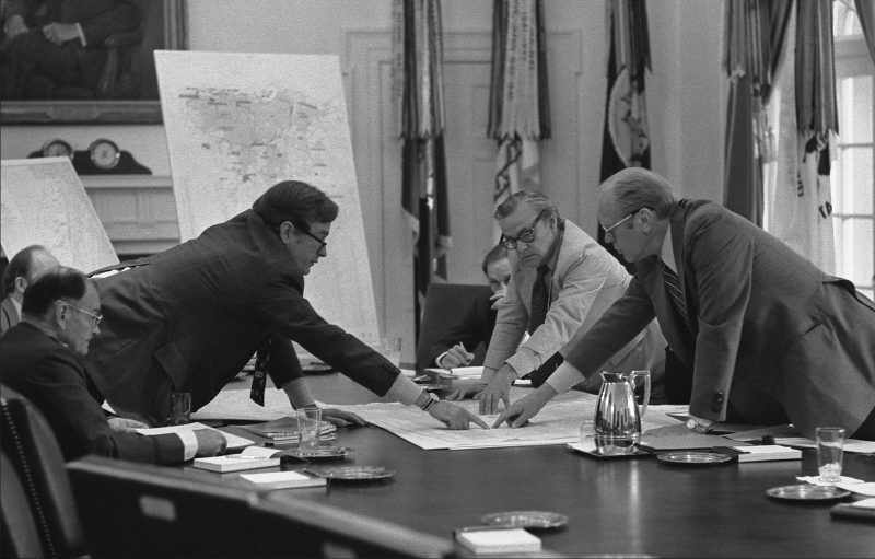 Director of the CIA George H.W. Bush briefing President Ford on the middlel east in 1974 with a Hexagon photo of the middle east (from the CIA) .jpg