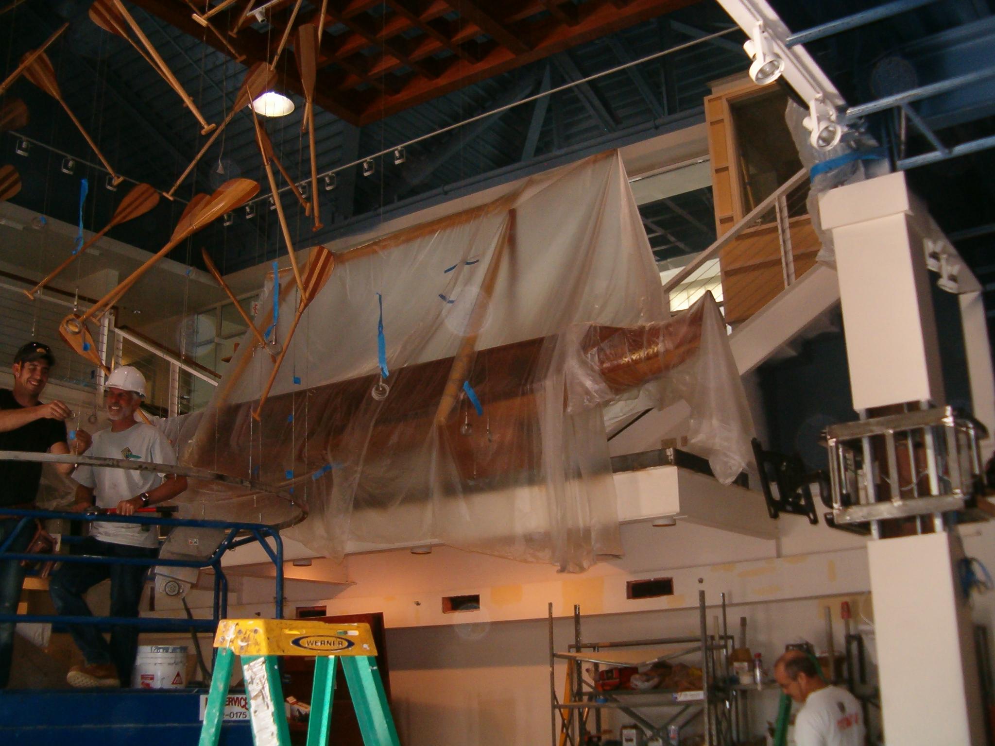 02 Hoisting Canoe to Ceiling.JPG