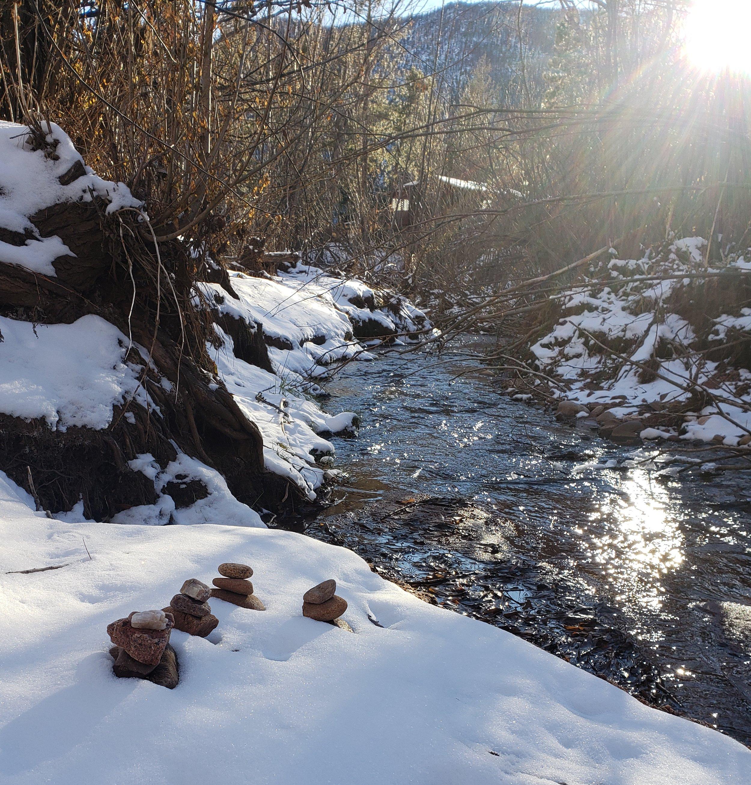 cairns in snow with sunburst.jpg