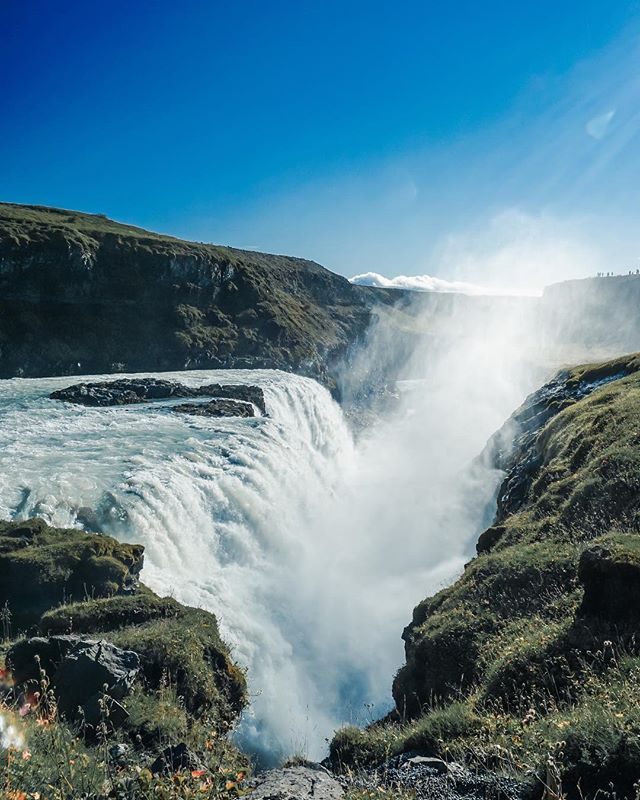 Gullfoss (Golden Falls) up close. Average waterfall at 140 cubic meters per second. It is a pretty amazing feeling to see and feel such a strong waterfall up close. . . . . . . #Iceland #photographyig #artofvisuals #landscapecapture #earthcapture #goneoutdoors #beautifuldestinations #createeploretakeover #outplanetdaily #lensculture #thevisualgrams #moodygrams #neverstopexploring #earthoffical #wowplanet #wanderfolk #lensbible #peoplecreative #moodnation #agameoftones #visualsoflife  #thephotosociety #europe #waterfall #gullfoss #goldenfall #travel #adventures #travelblogger #goldencircle