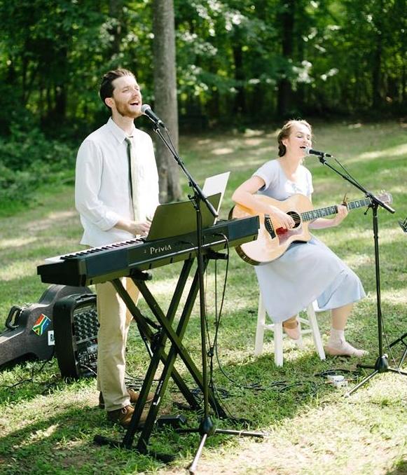 sarah & Jordan singing at oakleys wedding.jpg