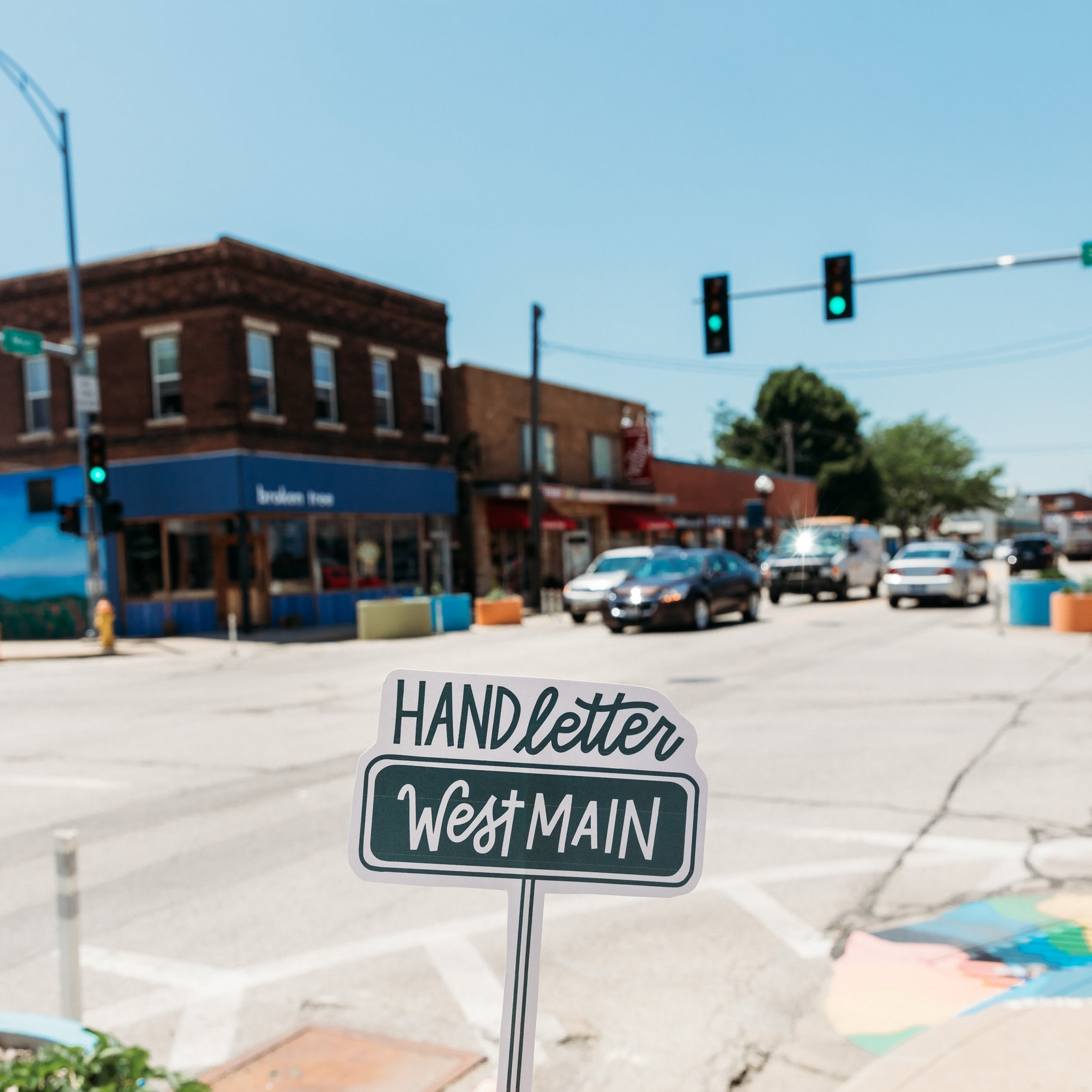HAND LETTER WEST MAIN - Local creatives, Chelsie & Sarah, beautify West Main Street through creatively updating handwritten signage in local businesses' storefronts and show the difference intentional design can make through professional photography.