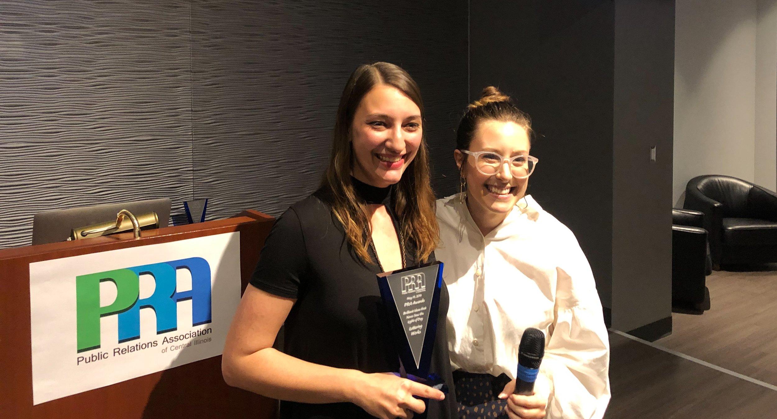 "Chelsie Tamms receives the ""Brilliant Ideas"" Award from PRA Board Member, Liz Gunty."