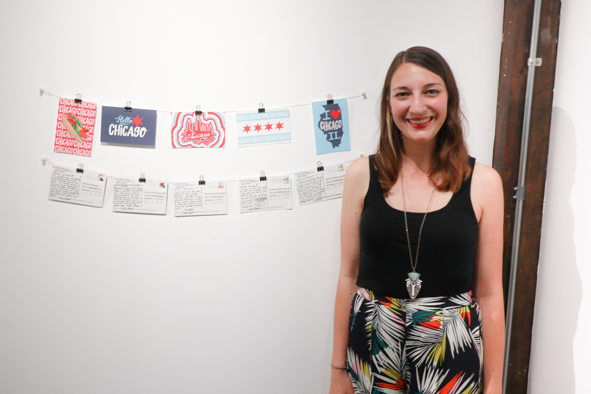 Chelsie Tamms in front of the Chicago Style Postcards Installation