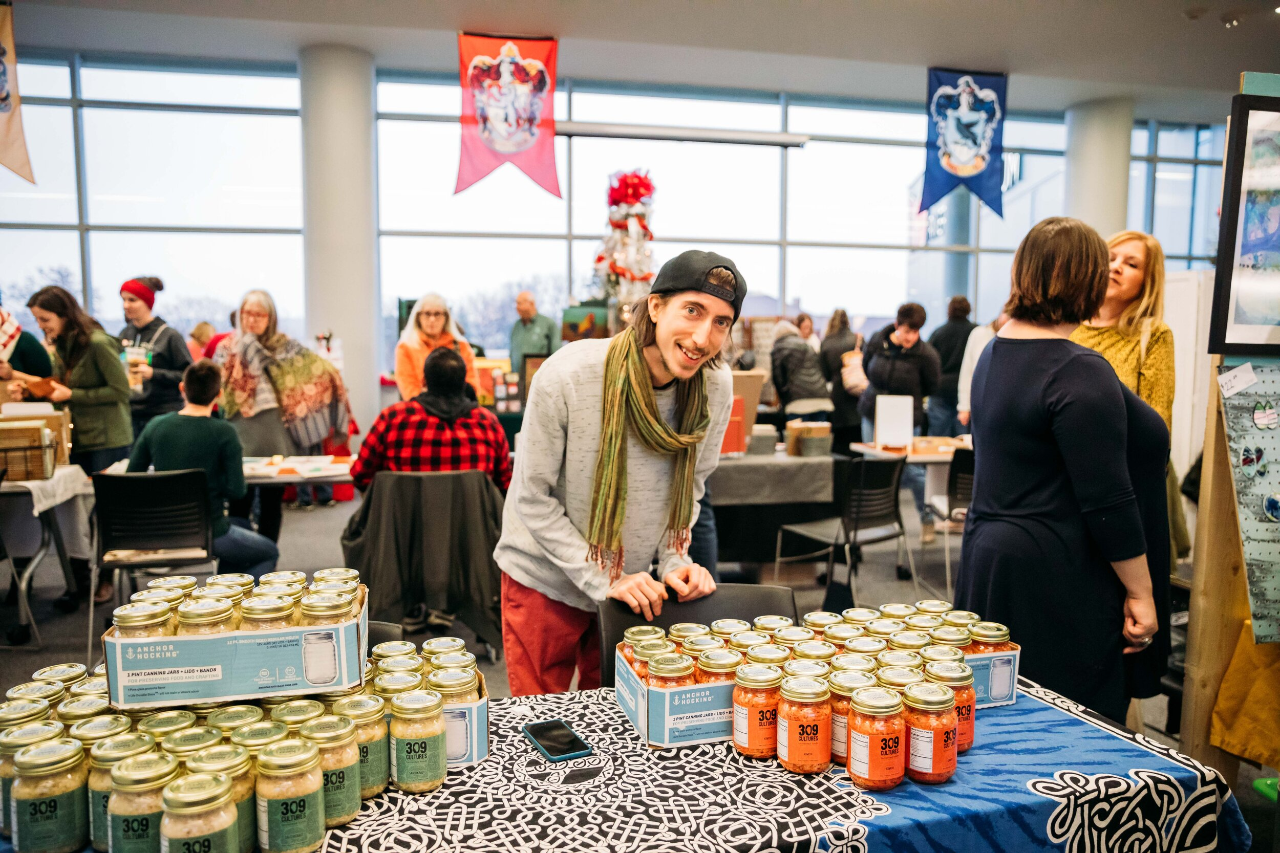 Joe Zich selling 309 Cultures Sauerkraut and Kimchi at his first market, the 25 on the 25th Makers Market, at the Peoria Riverfront Museum in November 2018.