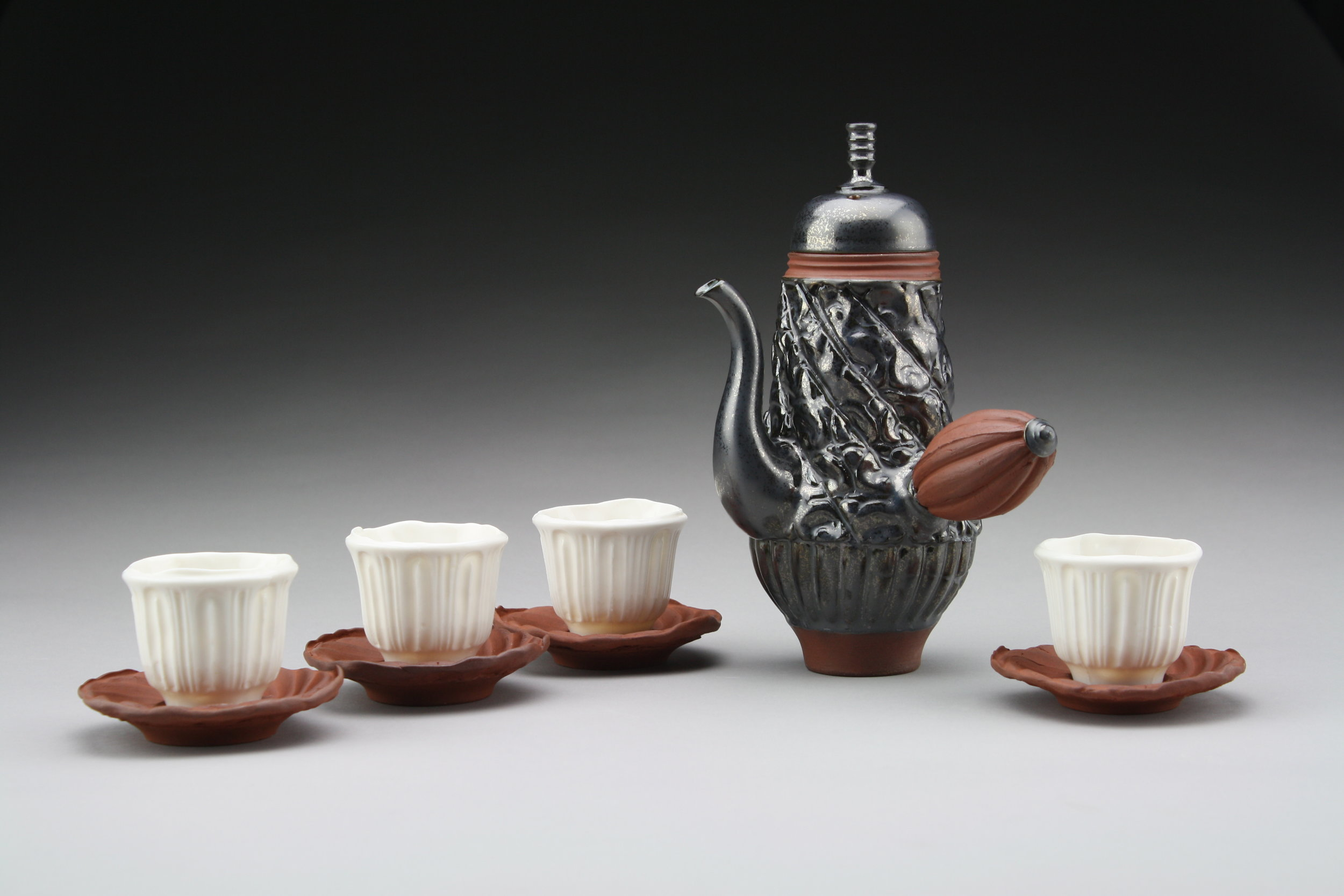 "Blair Clemo ,  Espresso Pot and Cups , 2014                         Red stoneware, 9"" x 6"" x 7"" Image courtesy of the artist"