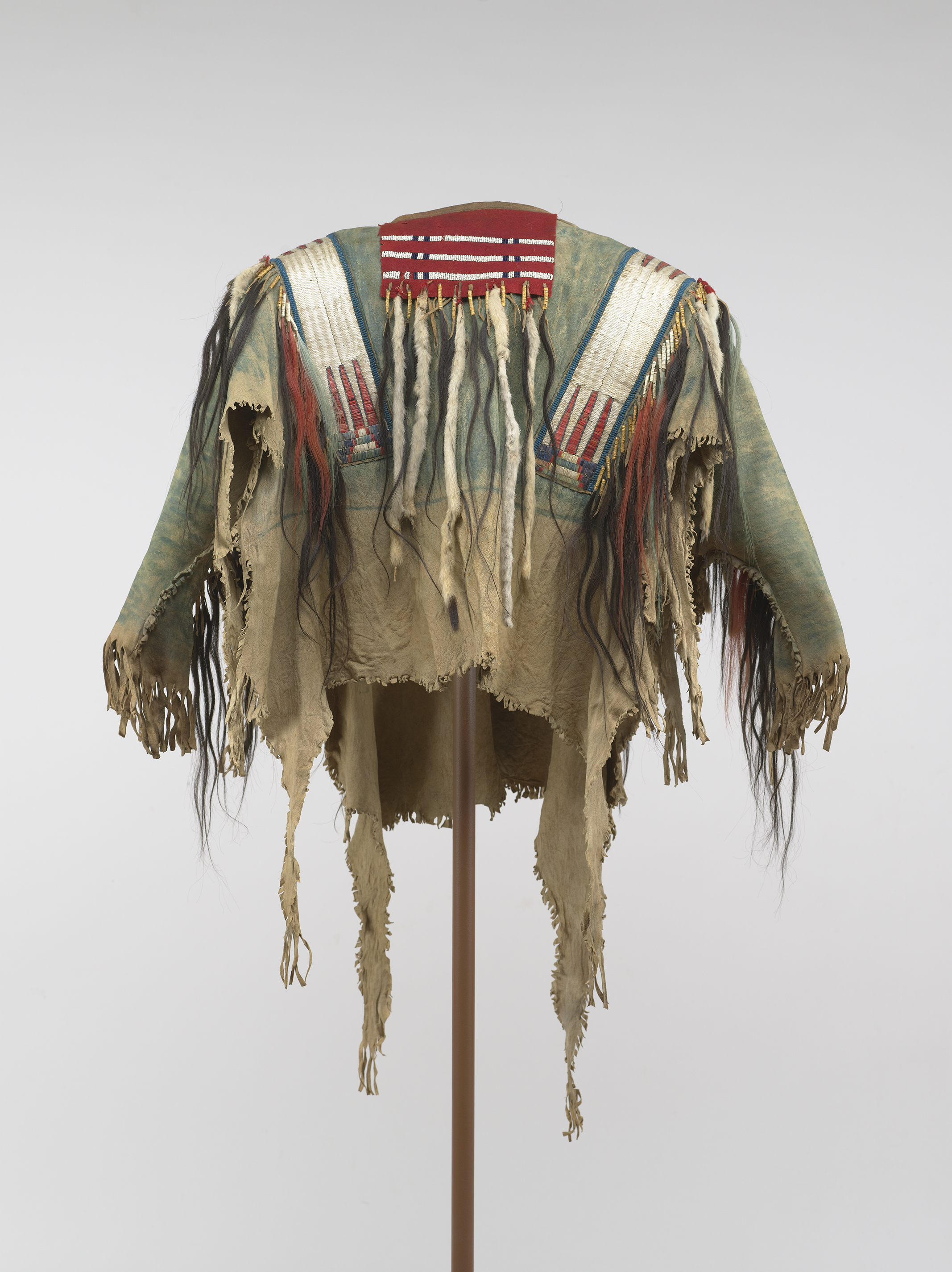 War Shirt , 1850-1880  Crow, elk or antelope hide, porcupine quills, ermine, horsehair, glass beads, pigment  Virginia Museum of Fine Arts; Adolph. D and Wilkins C. Williams Fund. Photo by Katherine Wetzel © Virginia Museum of Fine Arts