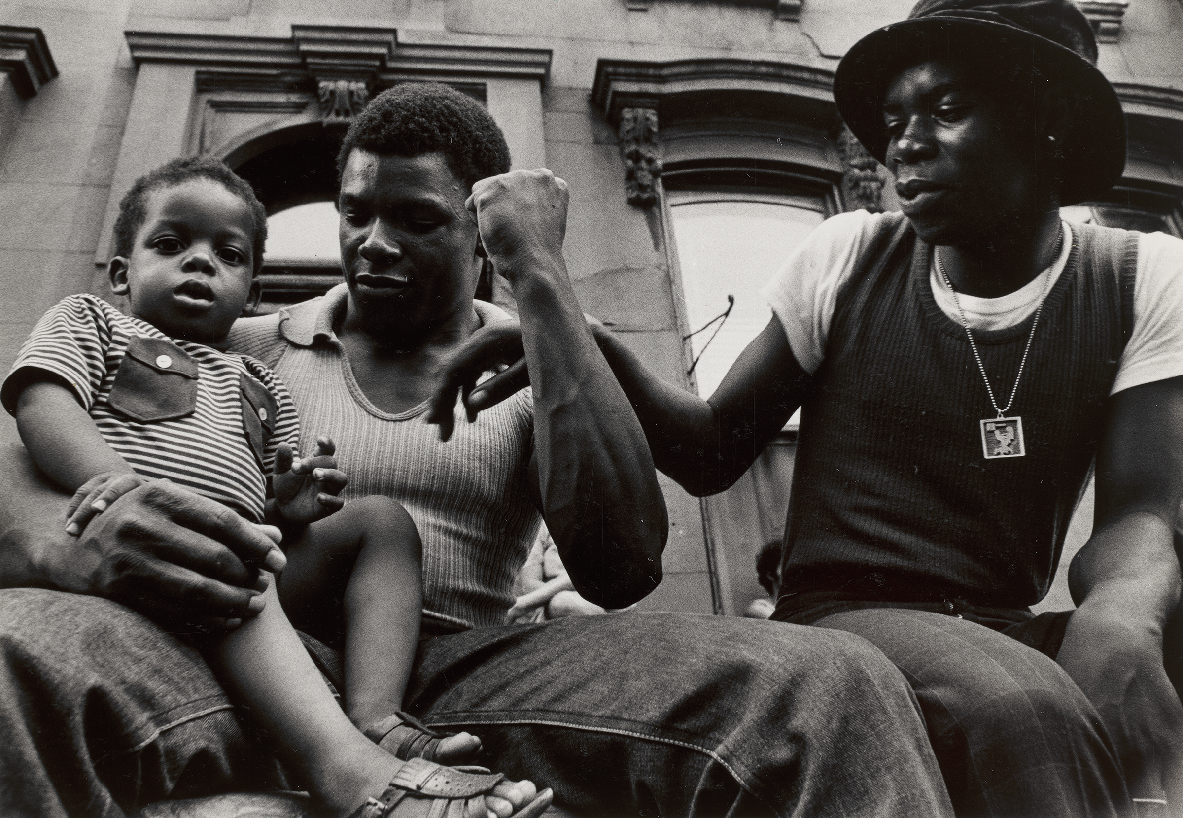 """Chester Higgins,  Male bonding , 1973  Gelatin silver print,6 13/16""""H × 9⅞""""W  Collection of the Artist. Courtesy of the Virginia Museum of Fine Arts, Richmond"""