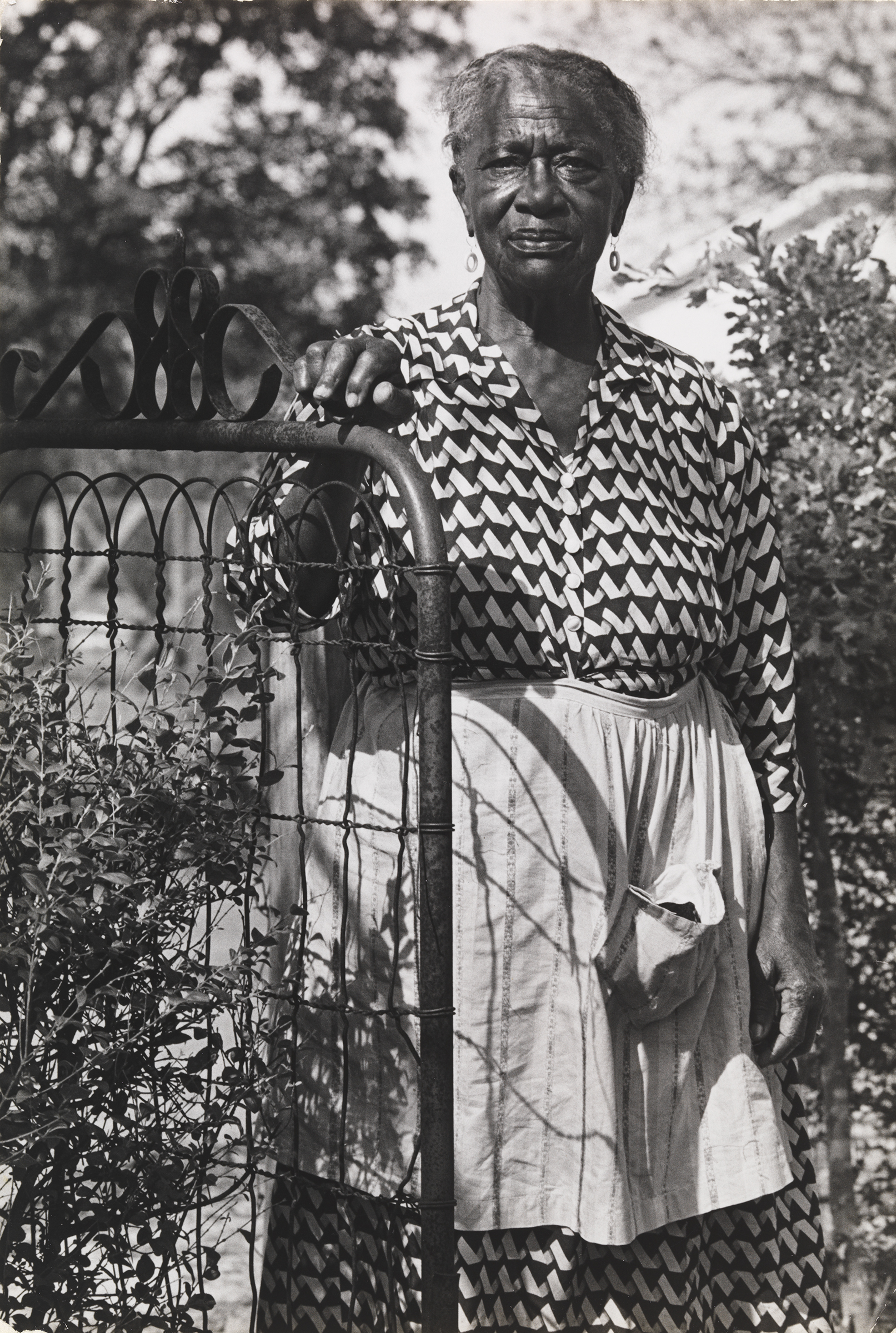"""Chester Higgins ,  T   he Artist's Great-Aunt Shugg Lampley, New Brockton, Alabama, 1968   Gelatin silver print, 9¾""""H × 6⅝""""W  Virginia Museum of Fine Arts, Richmond, National Endowment for the Arts Fund for American Art"""
