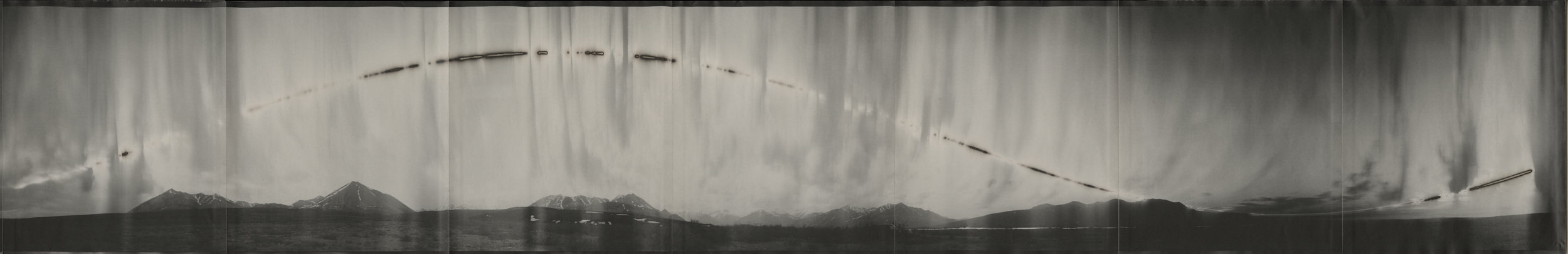 Chris McCaw ,  Cirkut #6 (Mostly cloudy Galbraith Lake, Alaska, within the Arctic Circle, 28 hours),  2015   Unique Gelatin Silver Paper Negative, 10 x 60 inches  Image courtesy of Candela Books and Gallery