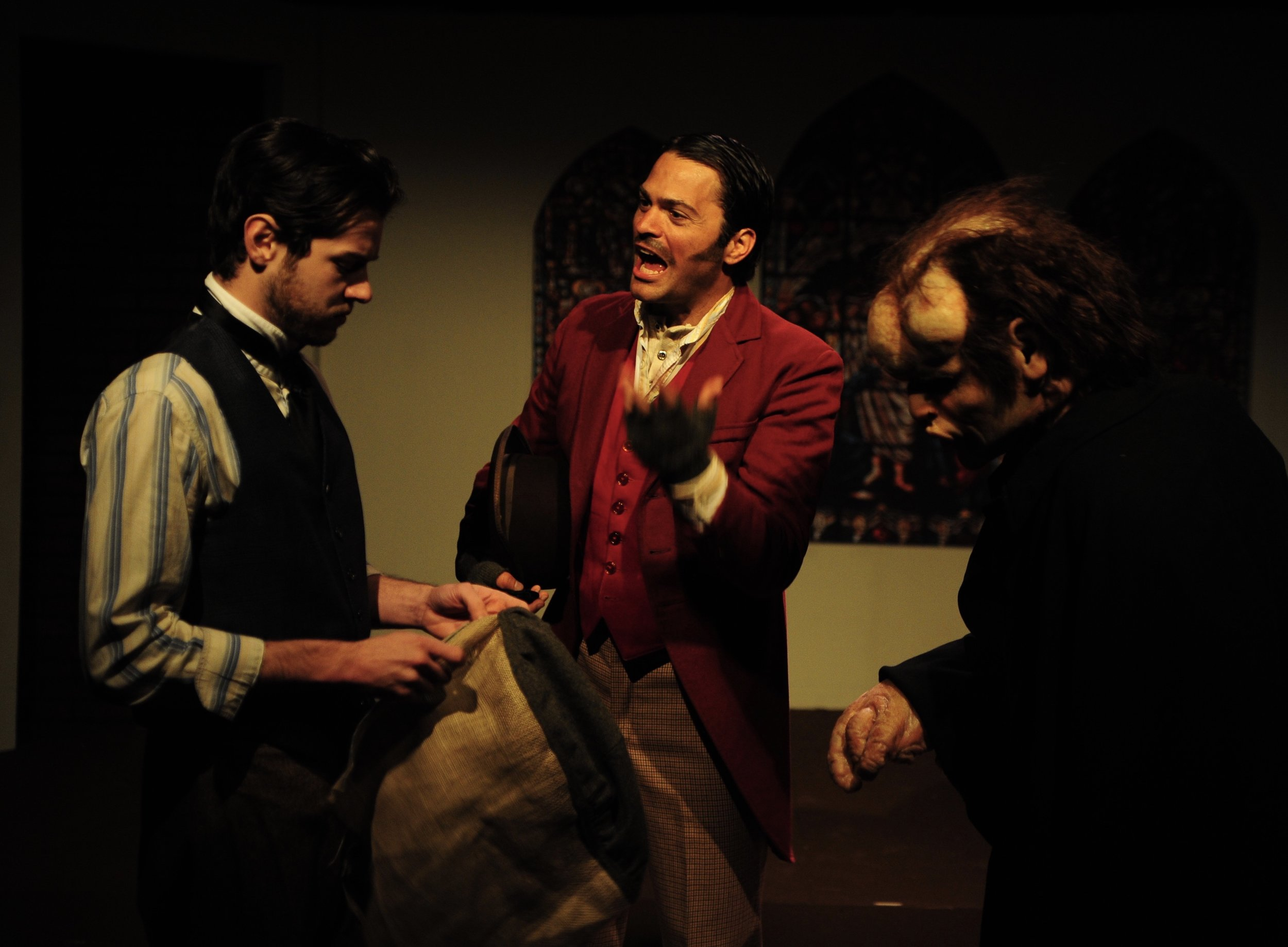 Caleb Neet (Conductor), David Folsom (Ross), and Sean Hoagland (John Merrick) in Lascaux Entertainment's 2011 production of  The Elephant Man , directed by John Drouillard.  Photo by Alysa Brennan.