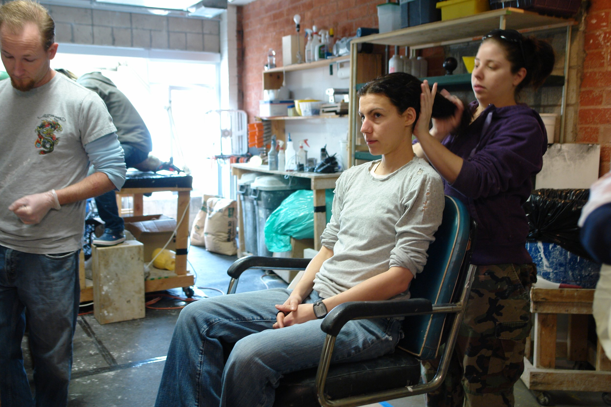 Yusuke Tateishi works in the background at Barney Burman's B2FX shop as fellow make-up effects artists Travis Weikel and Lee Komet prep actor Margarita Maliagros for a life cast as part of her special character make-up as Pinhead M in Lascaux Entertainment's 2011 production of  The Elephant Man , directed by John Drouillard.  Photo by Natalie Drouillard.
