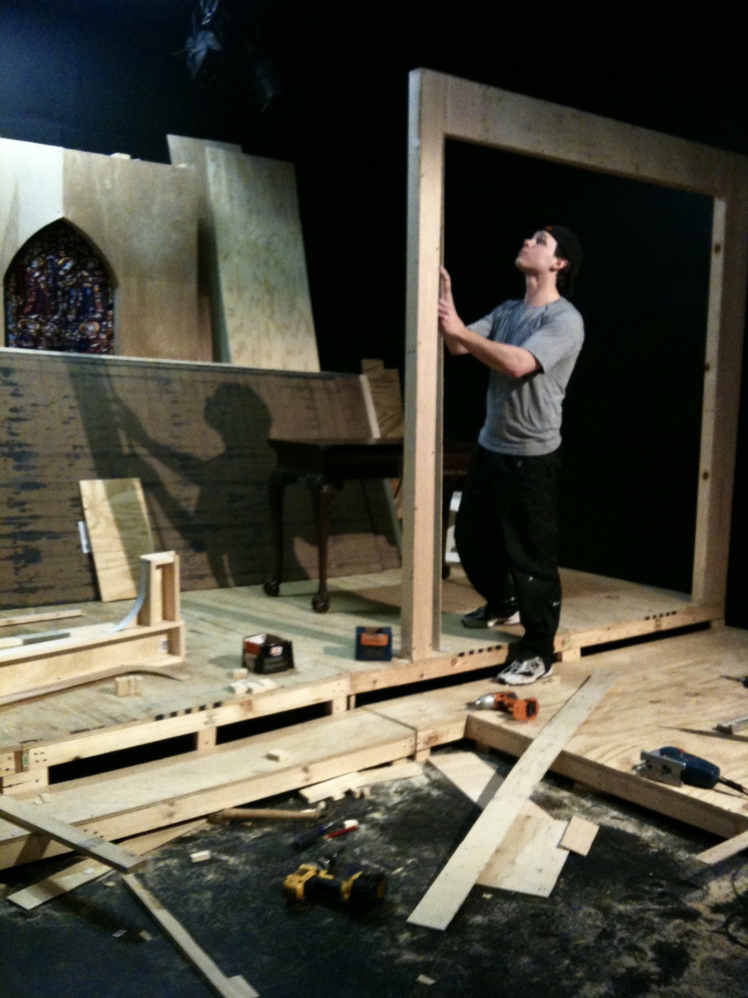 Actor Sean Hoagland lends a hand with construction during the load-in of Lascaux Entertainment's 2011 production of  The Elephant Man , directed by John Drouillard.  Photo by Natalie Drouillard.
