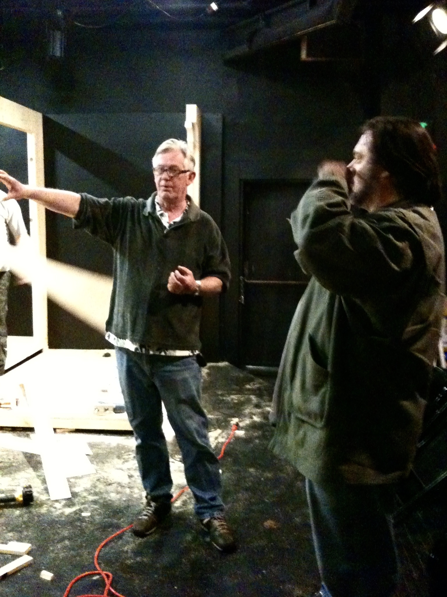 Lighting designer Richard Taylor and director John Drouillard talk over some details during the load-in of Lascaux Entertainment's 2011 production of  The Elephant Man , directed by Drouillard.  Photo by Natalie Drouillard.