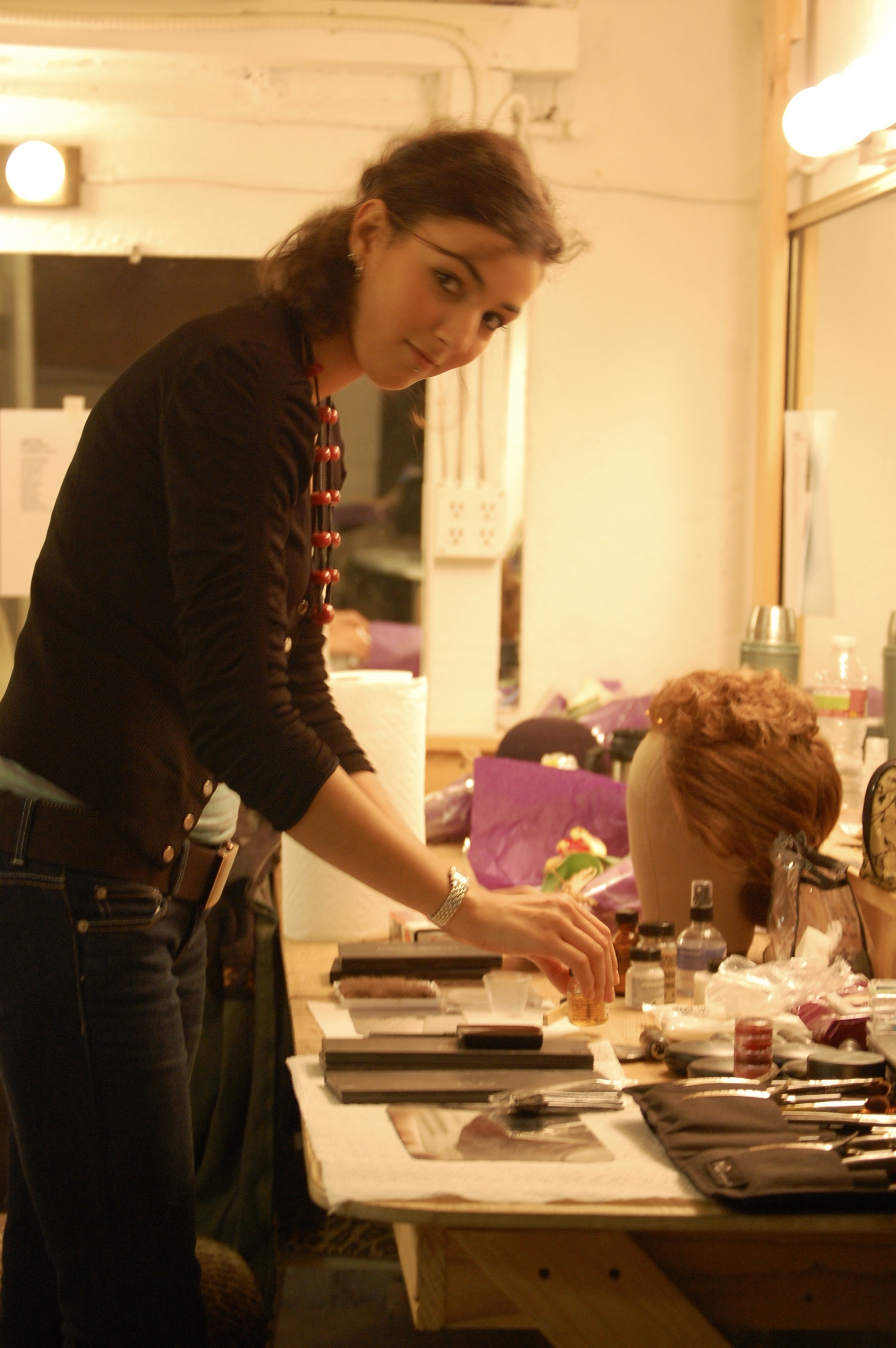 Make-up artist Boutheyna Boots getting things ready at her station backstage at Hollywood's El Centro Theatre during Lascaux Entertainment's 2011 production of  The Elephant Man , directed by John Drouillard.  Photo by Nirvana Kowlessar.