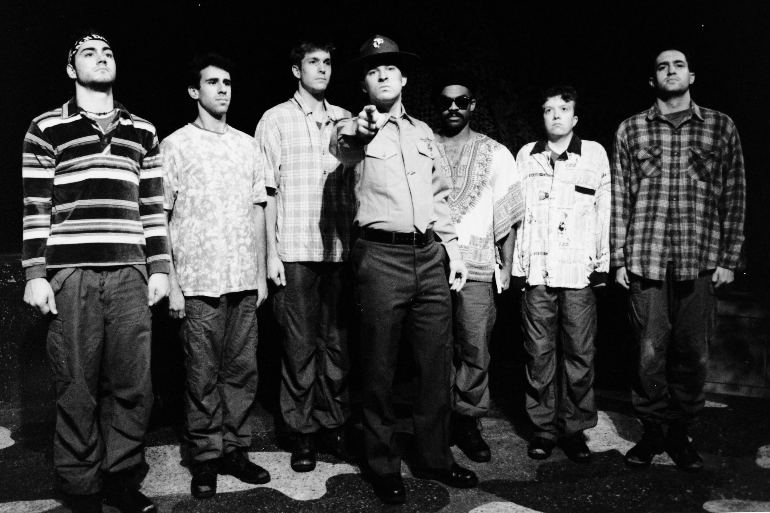 Chris Solari (Scooter), Chris Bilsky (Professor), William Vogt (Dinky Dau), Peter Winfield (Sgt. Williams), Gene Fereaud (Habu), Scott Freeburg (Baby San), and Scott Donnelly (Little John) in Draw the Sneck Productions'1996 | 1997 productions of  Tracers , directed by John Drouillard.  Photo by Paul Backer.