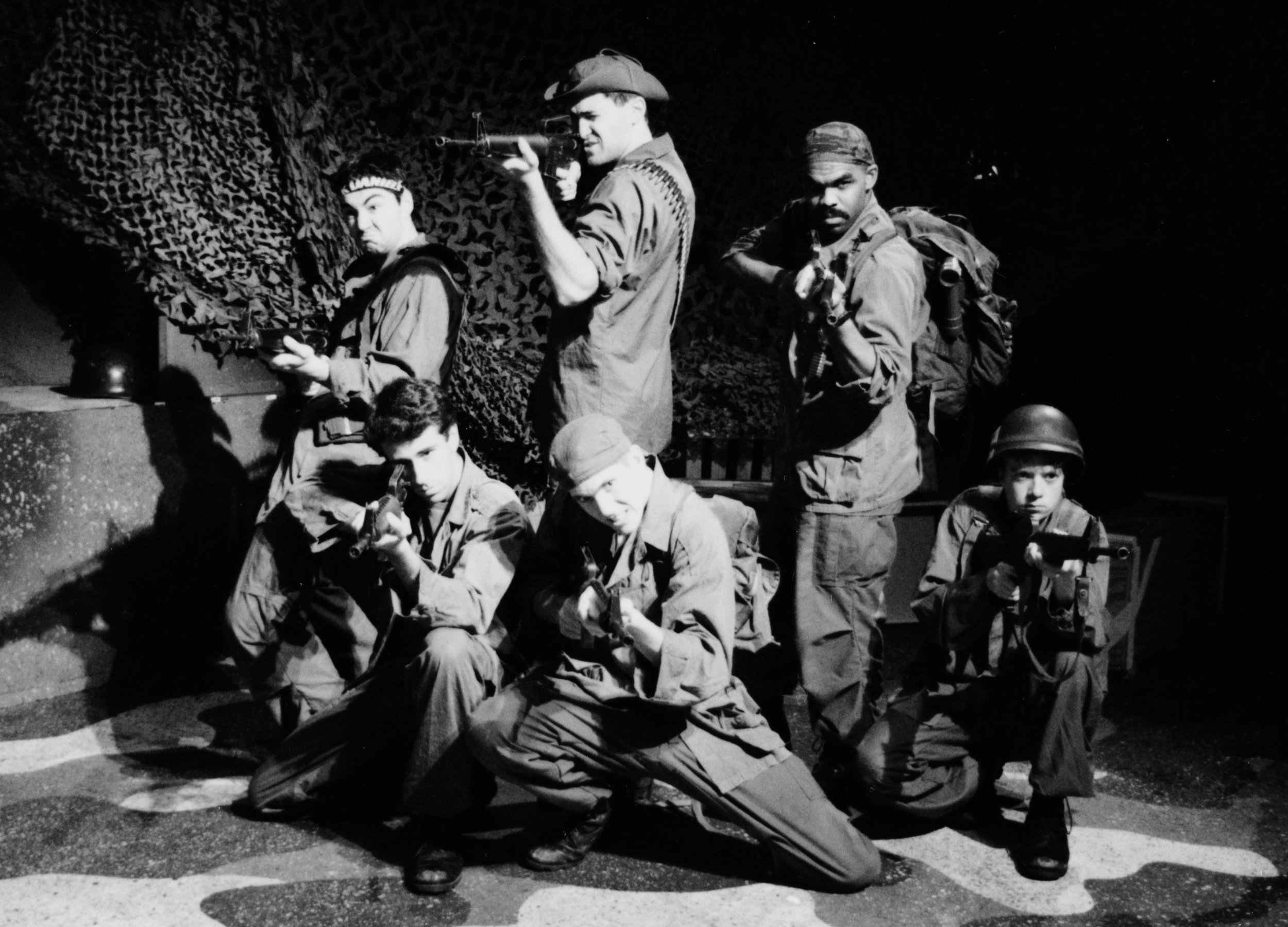 Chris Solari (Scooter), Craig Bilsky (Professor), Scott Donnelly (Little John), William Vogt (Dinky Dau), Gene Fereaud (Habu), and Scott Freeburg (Baby San) in Draw the Sneck Productions'1996 | 1997 productions of  Tracers , directed by John Drouillard.  Photo by Paul Backer.