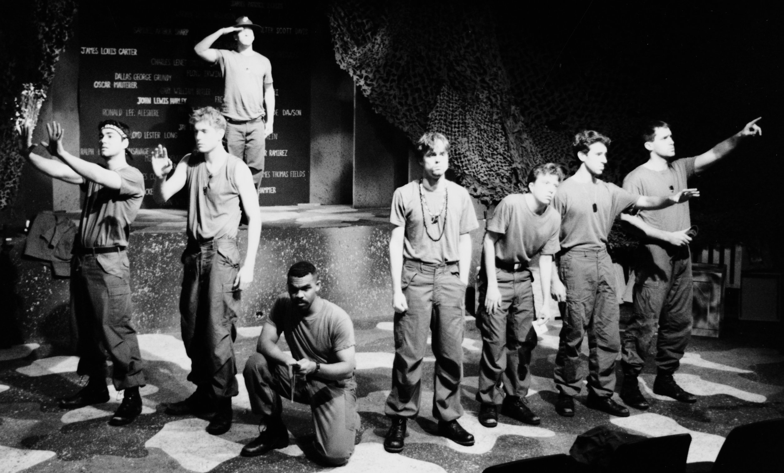 Chris Solari (Scooter), William Vogt (Dinky Dau), Peter Winfield (Sgt. Williams), Gene Fereaud (Habu), Andy Hungerford (Doc), Scott Freeburg (Baby San), Craig Bilsky (Professor), and Scott Donnelly (Little John) in Draw the Sneck Productions'1996 | 1997 productions of  Tracers , directed by John Drouillard.  Photo by Paul Backer.