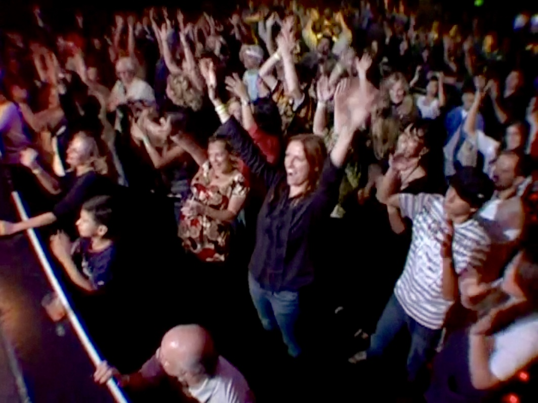 Excited audience members at GLAD & Sprint Relay's 2007 concert  Beethoven's Nightmare Live At The El Rey , produced by Bob Hiltermann, John Drouillard, and Natalie Drouillard.  Still from Worldplay, Inc.'s 2010 feature documentary,  See What I'm Saying , cinematography by Jeff Gatesman, directed by Hilari Scarl.