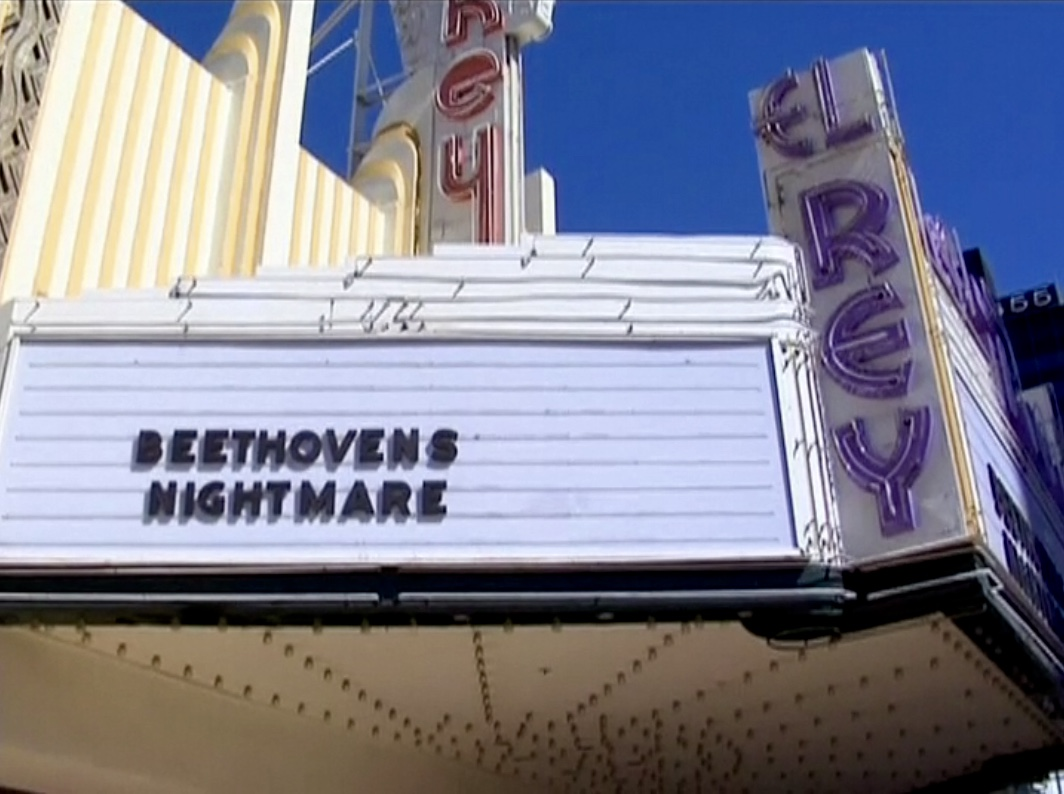 The marquee of the historic El Rey Theatre in Los Angeles the day of GLAD & Sprint Relay's 2007 concert  Beethoven's Nightmare Live At The El Rey , produced by Bob Hiltermann, John Drouillard, and Natalie Drouillard.  Still from Worldplay, Inc.'s 2010 feature documentary,  See What I'm Saying , cinematography by Jeff Gatesman, directed by Hilari Scarl.