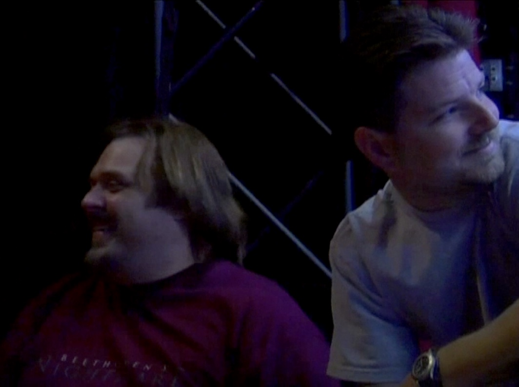 Producer John Drouillard and stage manager Christopher Beyries during load-in for GLAD & Sprint Relay's 2007 concert  Beethoven's Nightmare Live At The El Rey , produced by Bob Hiltermann, John Drouillard, and Natalie Drouillard.  Still from Worldplay, Inc.'s 2010 feature documentary,  See What I'm Saying , cinematography by Jeff Gatesman, directed by Hilari Scarl.
